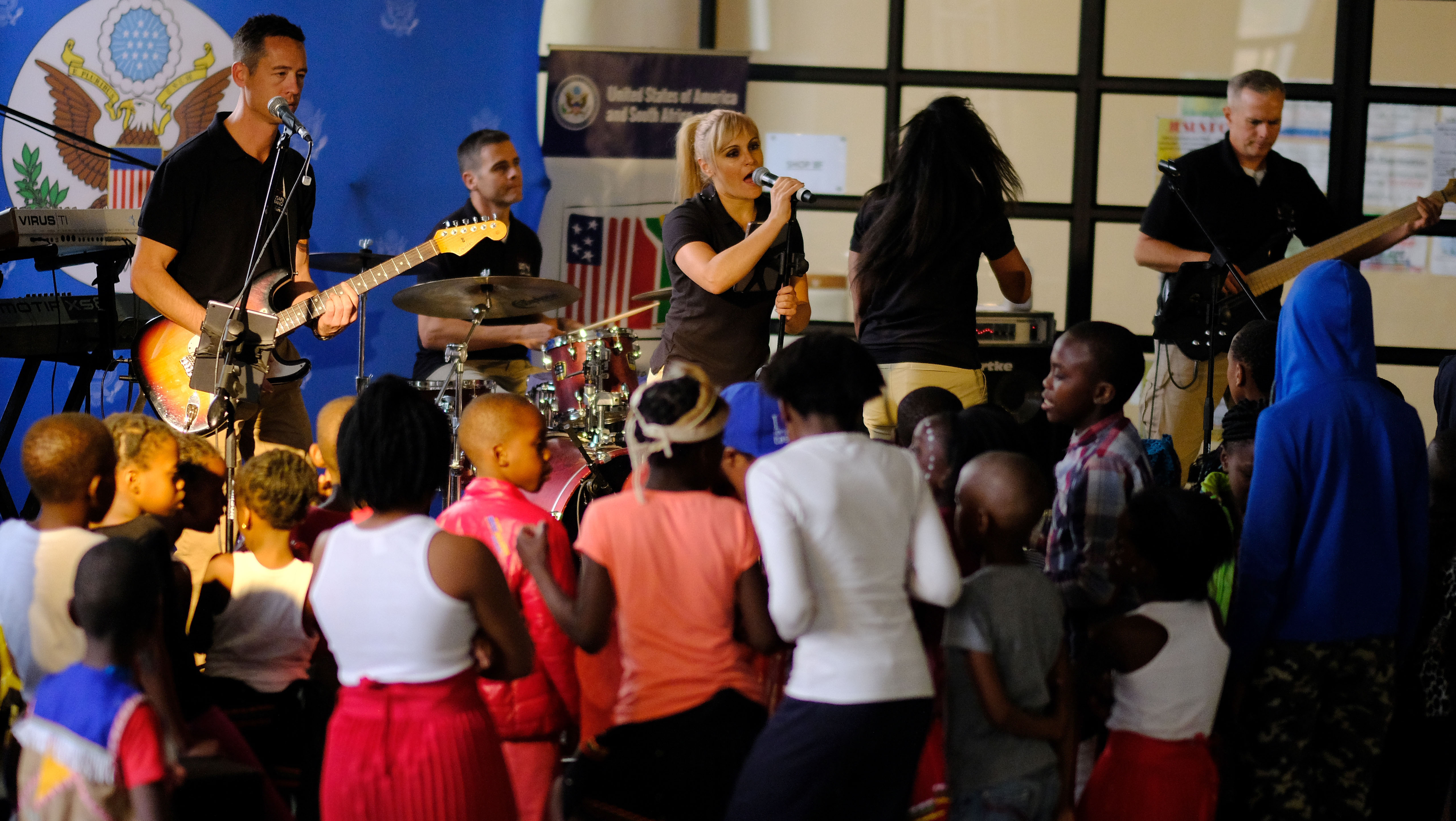 Members of the United States Air Forces in Europe- Air Forces Africa band  Touch 'n Go perform a concert for children at Ponte City in Johannesburg, South Africa, September 21, 2018. The band's performance provides a unique opportunity for the U.S. to develop strong connections with its African partners and their communities. (US Army Photo by SSG Jeffery Sandstrum)