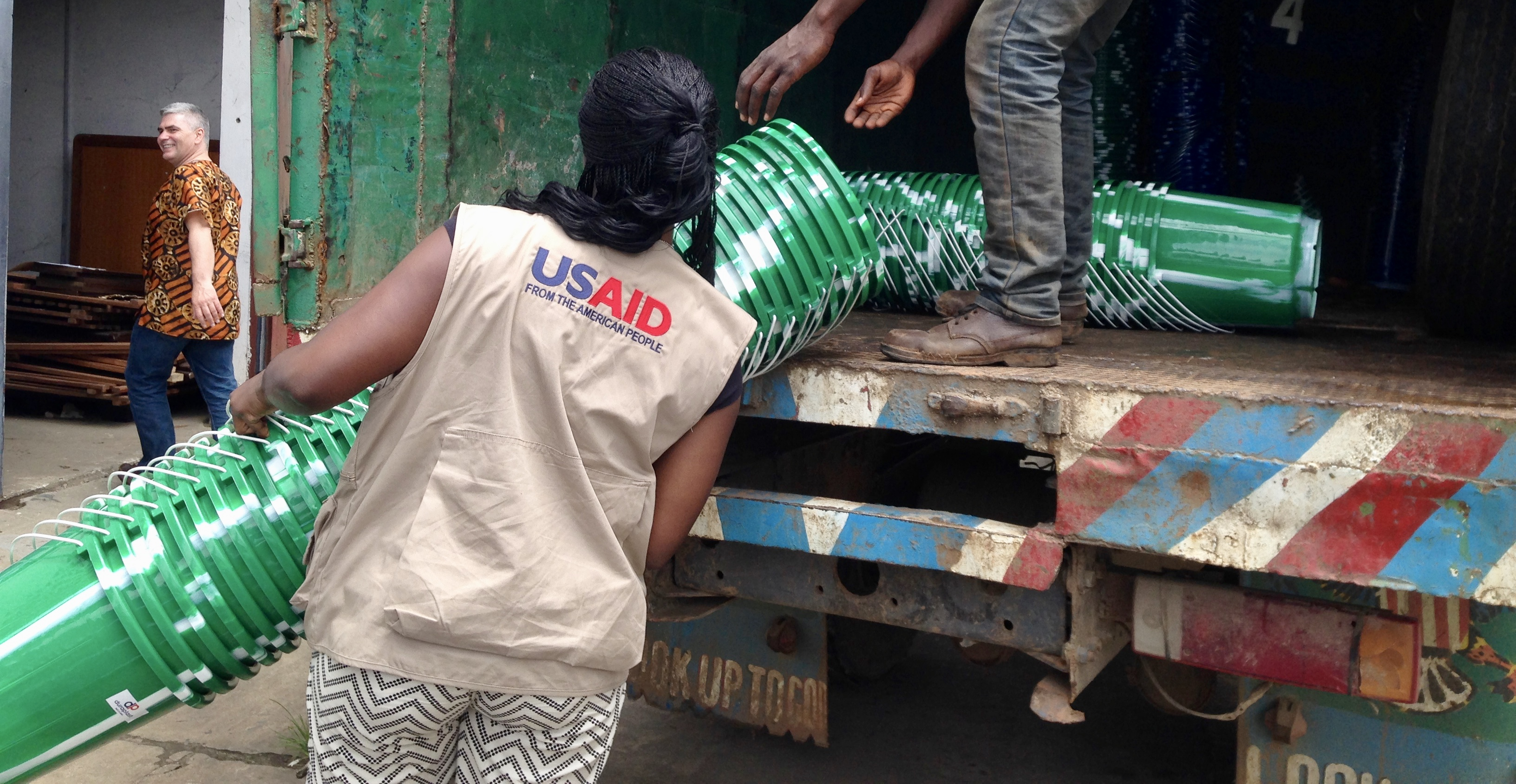 USAID deploys a Disaster Assistance Response Team (DART) to crisis-affected areas. Here, a DART procures hygiene items for Ebola response, Aug. 27, 2014. (Photo by Sarah McElroy, USAID Office of Foreign Disaster Assistance (OFDA))