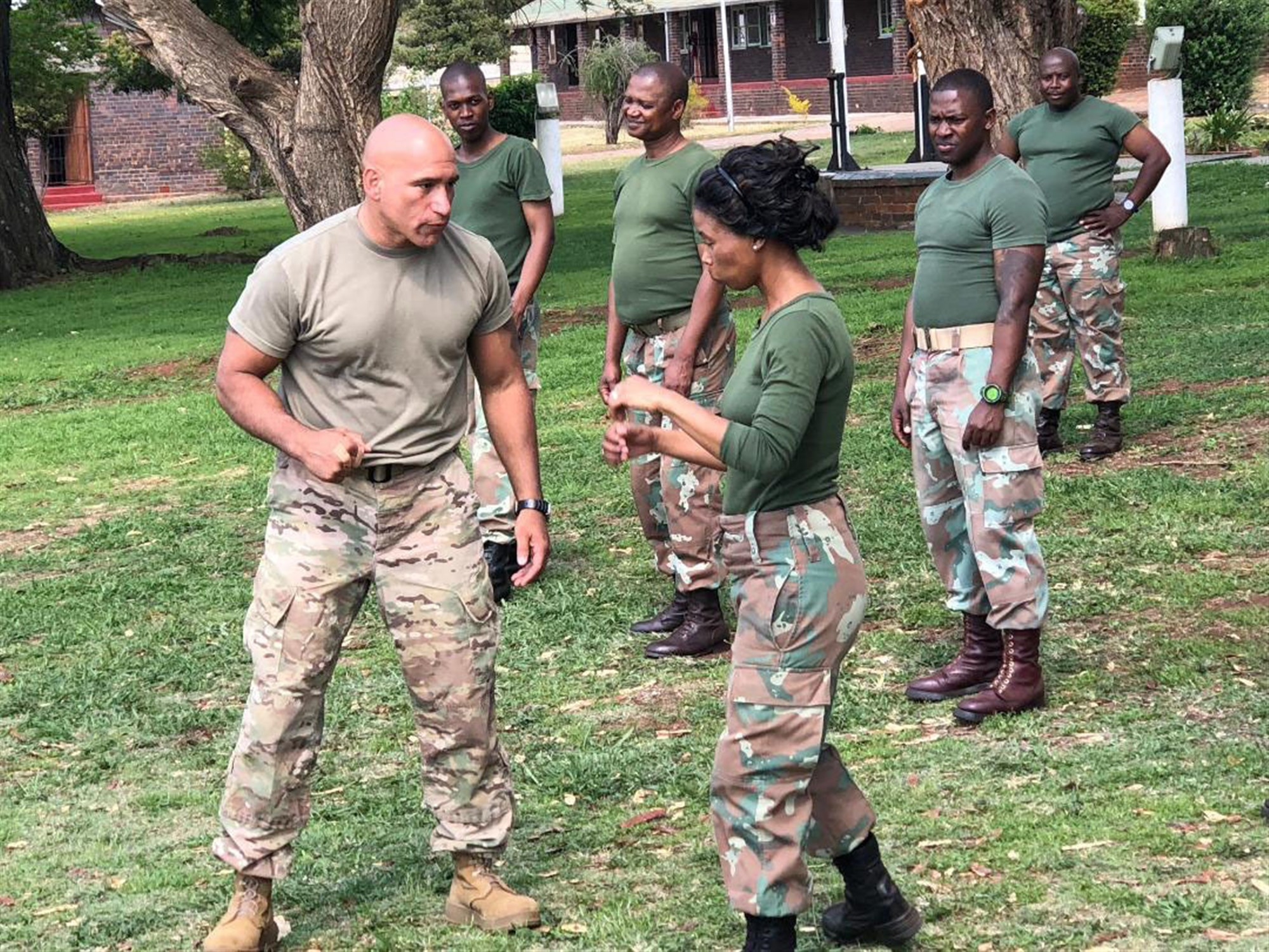 New York Army National Guard Master Sgt. Luis Barsallo, a certified hand-to-hand tactics instructor, demonstrates a move to members of the South African National Defense Forces during an  exchange visit on October 10, 2018. Soldiers from the New York Army National Guard took  part in an exchange program at the South African National Defense Forces Military Police School during an exchange visit there on Oct. 10-11, 2018. Twelve New York Army National Guard experts in civil support operations, military police, law enforcement, and self-defense took part in the exchange visit. ( U.S. Army National Guard photo by Sgt. Kristin Ross)