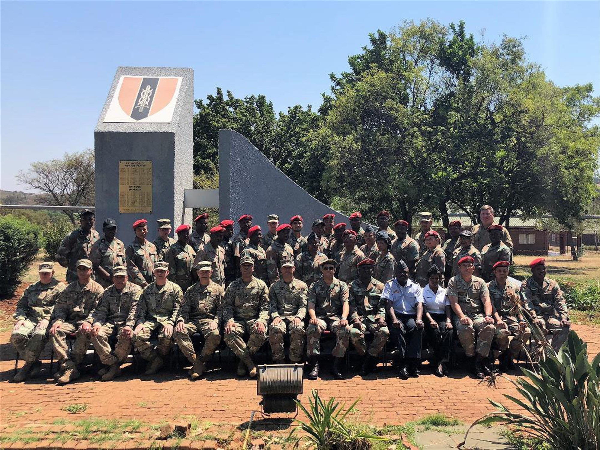 Soldiers from the New York Army National Guard pose with their hosts during an exchange program at the South African National Defense Forces Military Police School during an exchange visit there on Oct. 10-11, 2018. Twelve New York Army National Guard experts in civil support operations, military police, law enforcement, and self-defense took part in the exchange visit. ( U.S. Army National Guard photo by Major Al Phillips)