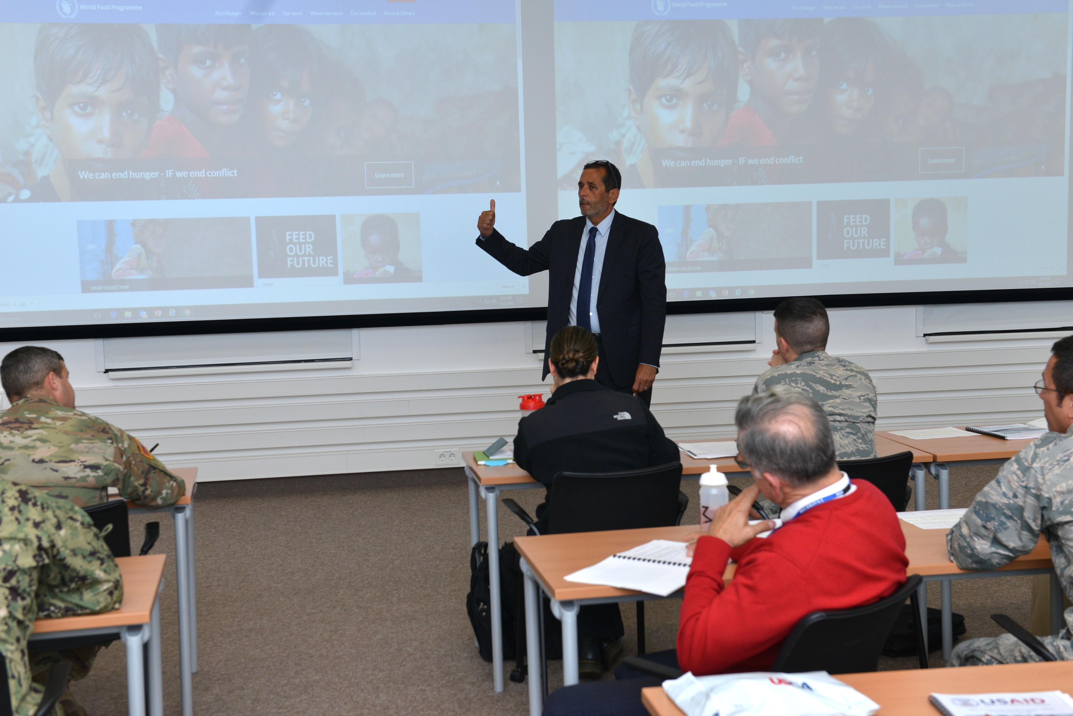 Amer Daoudi, Senior Director, Operations Services, U.N. World Food Program, U.N. World Food Program, addresses attendees of the Joint Humanitarian Operations Course, Oct. 4, 2018, at the U.S. Africa Command Special Events Center.