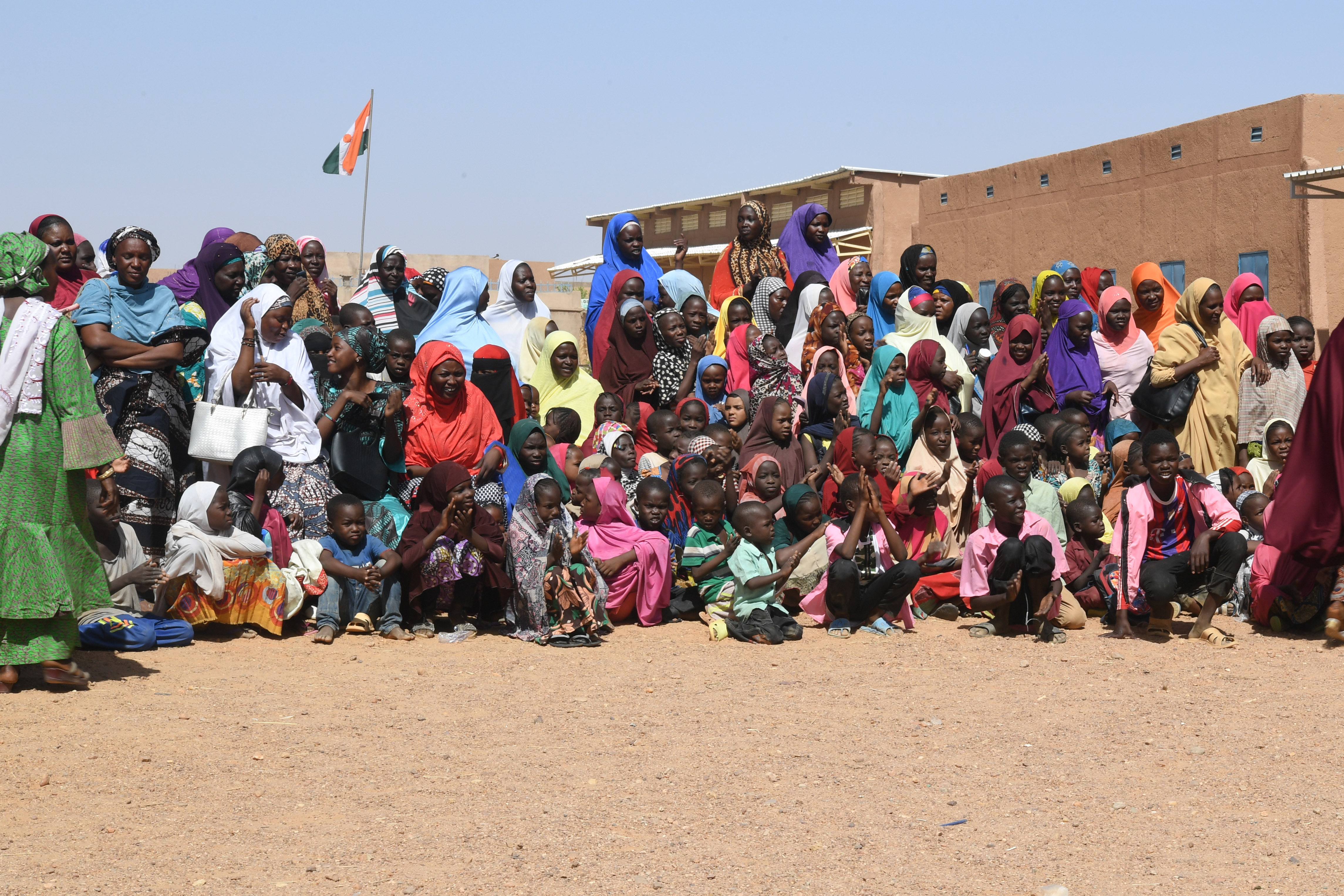 Teachers and students attend the ceremony in which 300 desks were donated to Misrata Primary School in Agadez, Niger, Oct. 23, 2018. Approximately 1,000 desks will be donated to schools in the local area along with school supplies collected by U.S. military members at Nigerien Air Base 201. (U.S. Air Force photo by Tech. Sgt. Rachelle Coleman)