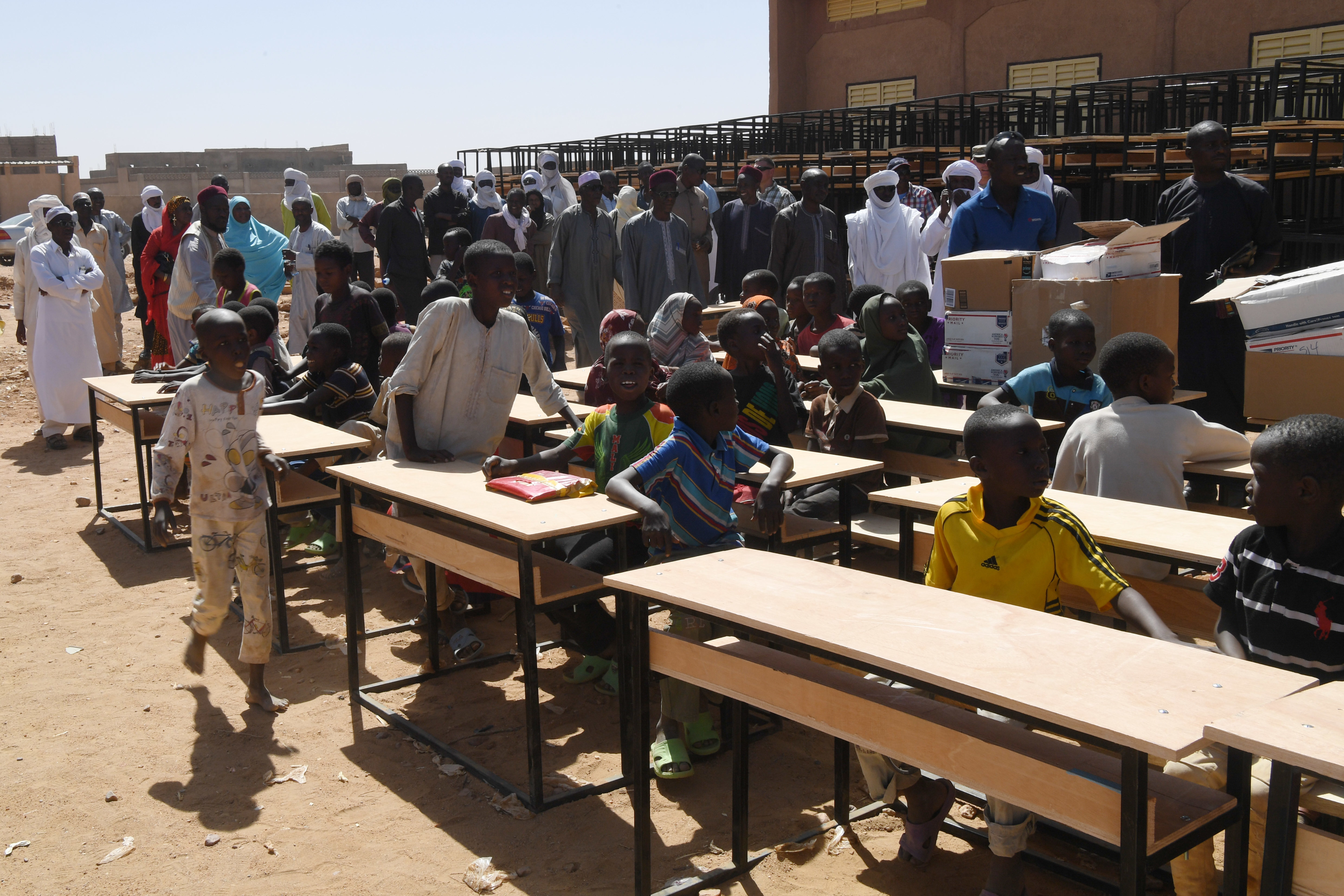 Misrata Primary School students check out the desks during a ceremony in Agadez, Niger, Oct. 23, 2018. Approximately 300 desks were donated to the primary school as part of a plan to donate 1,000 desks to schools in the Agadez region. (U.S. Air Force photo by Tech. Sgt. Rachelle Coleman)