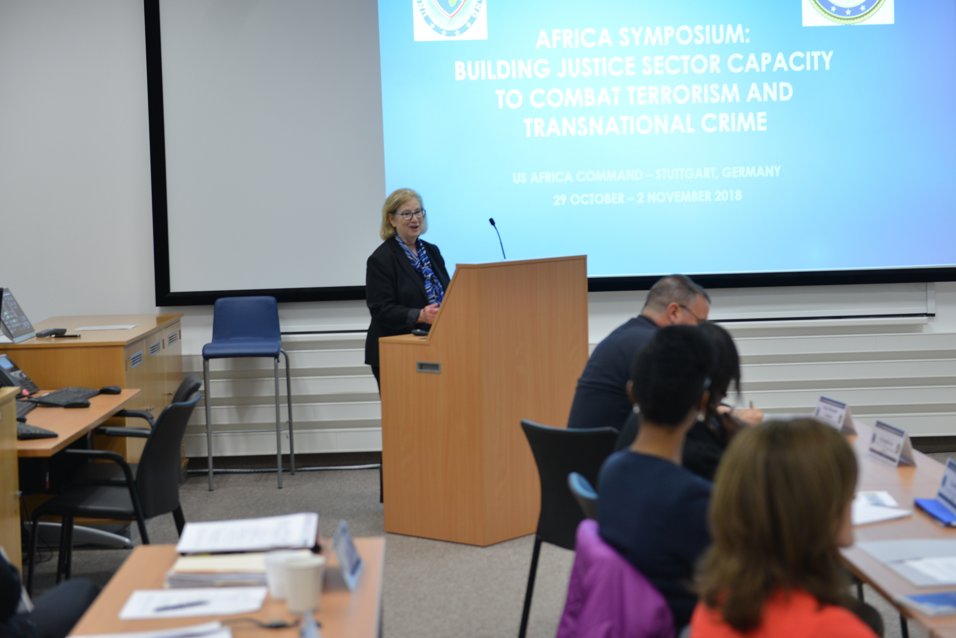 STUTTGART, Germany – Faye Ehrenstamm, Director of the Office of Overseas Prosecutorial Development, Assistance and Training, Criminal Division, U.S. Justice Department, addresses attendees of the first U.S. Africa Command hosted DOJ Africa Symposium at the Kelly Barracks Special Events Center, Oct. 29, 2018.