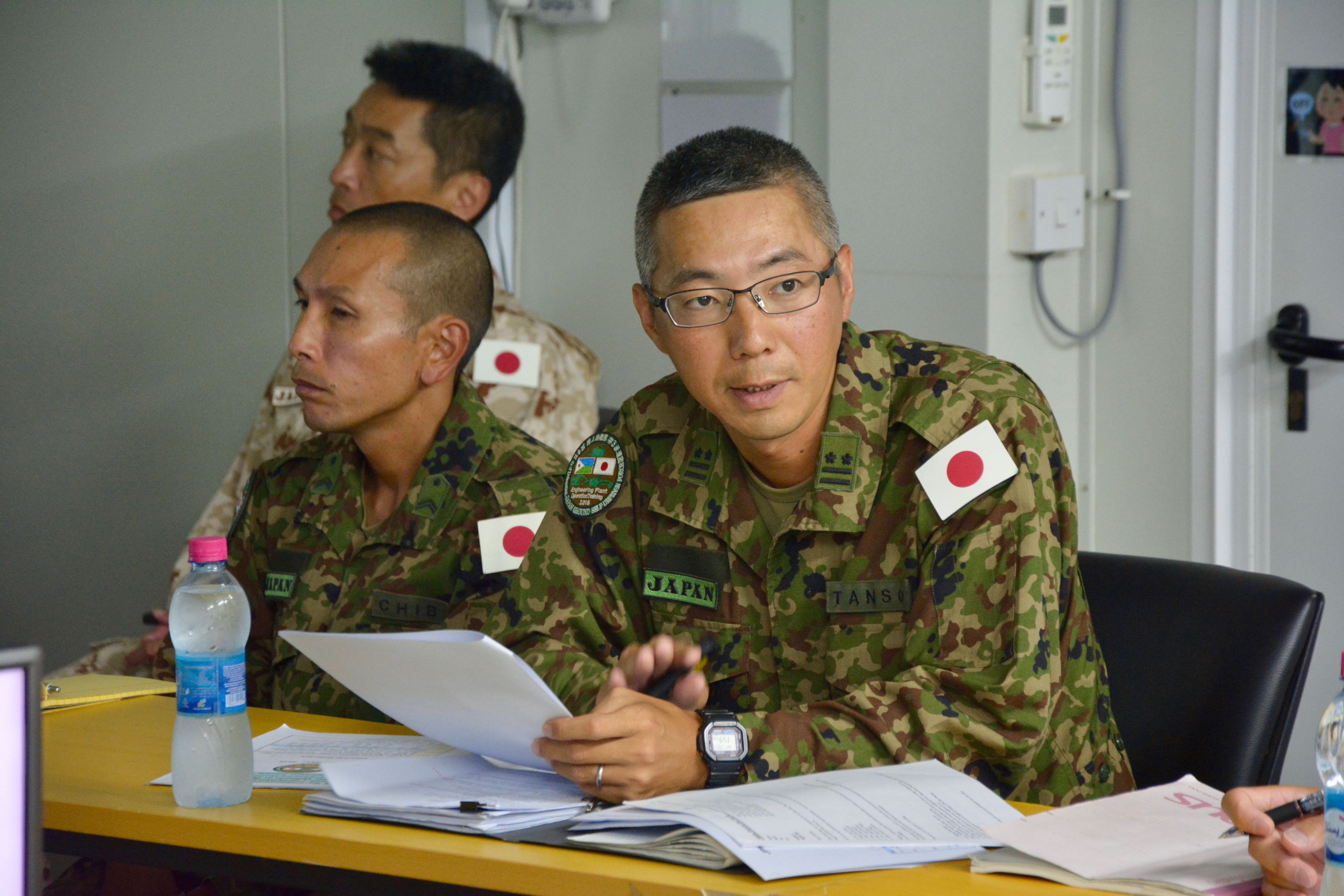 Japan Ground Self-Defense Force Col. Masatoshi Tanso briefs U.S. Army Lt. Col. Kenneth Kim, commander of the 403rd Civil Affairs Battalion, Mattydale, New York, during a key leadership engagement at Japan Self-Defense Force Base, Djibouti, Nov. 21, 2018. Japanese and U.S. leadership met to discuss ways to build relationships across the Combined Joint Operations Area. (U.S. Army Photo by Capt. Olivia Cobiskey)