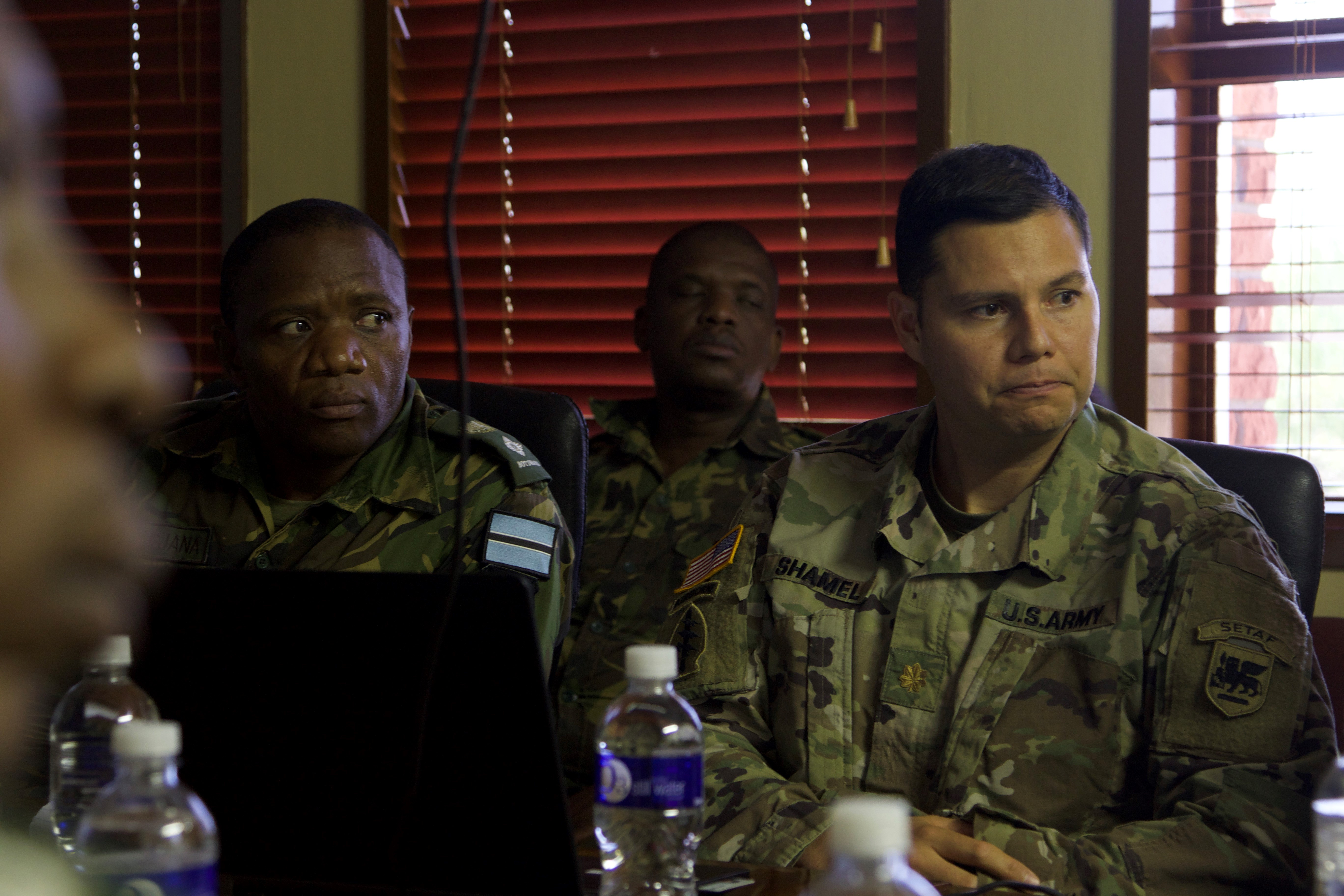 GABORONE, Botswana--Maj. Teremurra Shamel, the U.S. Army Africa Land Forces Summit lead planner, and lt. Col. BC Phejana, the Botswana Ground Forces Command ALFS lead planner, brief the Botswana GFC Commander Oct. 26, 2018, in Gaborone, Botswana. ALFS in an annual seminar attended by land force chiefs across Africa, where service leaders discuss common challenges and share best practices.