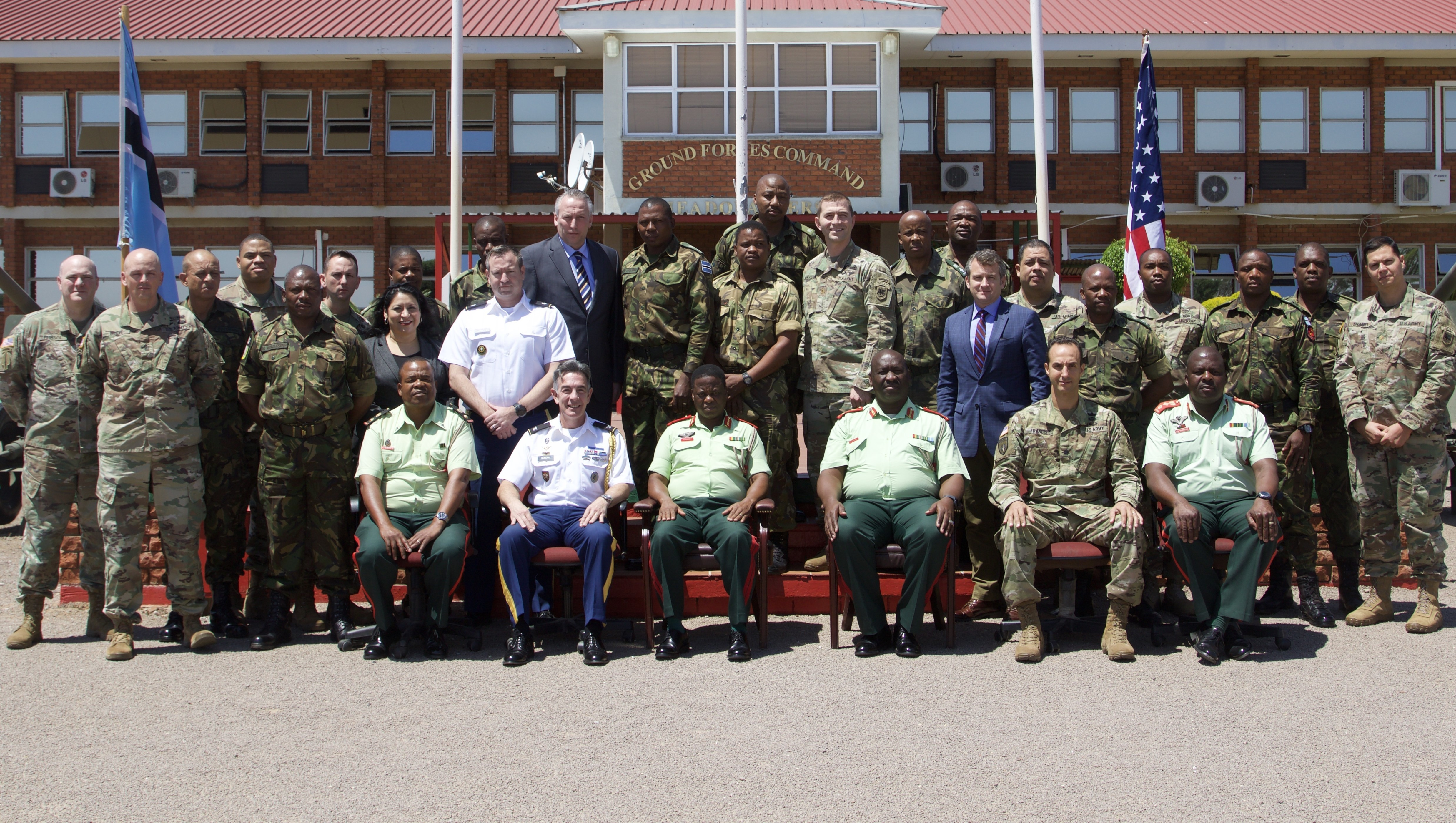 Lead planners from U.S. Army Africa and the Botswana Ground Forces take a group photo in front of the Botswana GFC headquarters Oct. 26, 2018, to signify the conclusion of the first planning event for the 2019 African Land Forces Summit 19. 