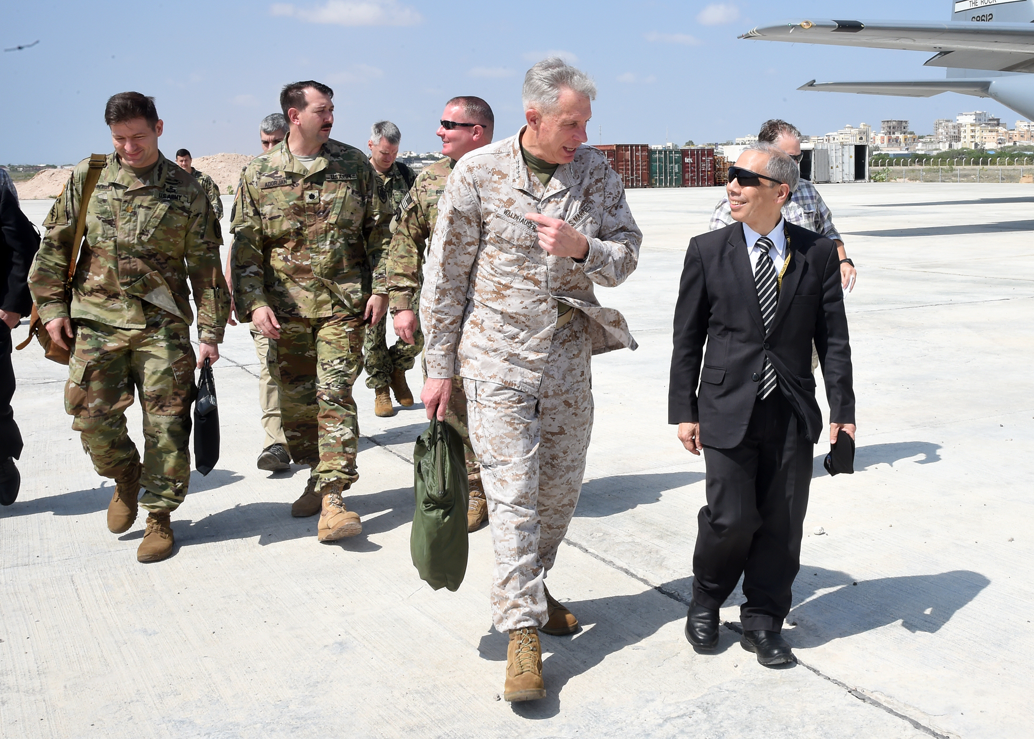 MOGADISHU, Somalia – U.S. Marine Gen. Thomas D. Waldhauser, commanding general, U.S. Africa Command, speaks with U.S. Ambassador to Somalia Donald Yamamoto, at Aden Adde International Airport in Mogadishu, Somalia Nov. 27, 2018. During his visit to Mogadishu, Waldhauser also met with Somali President Mohamed Abdullahi Mohamed to discuss development, security and stability in Somalia.