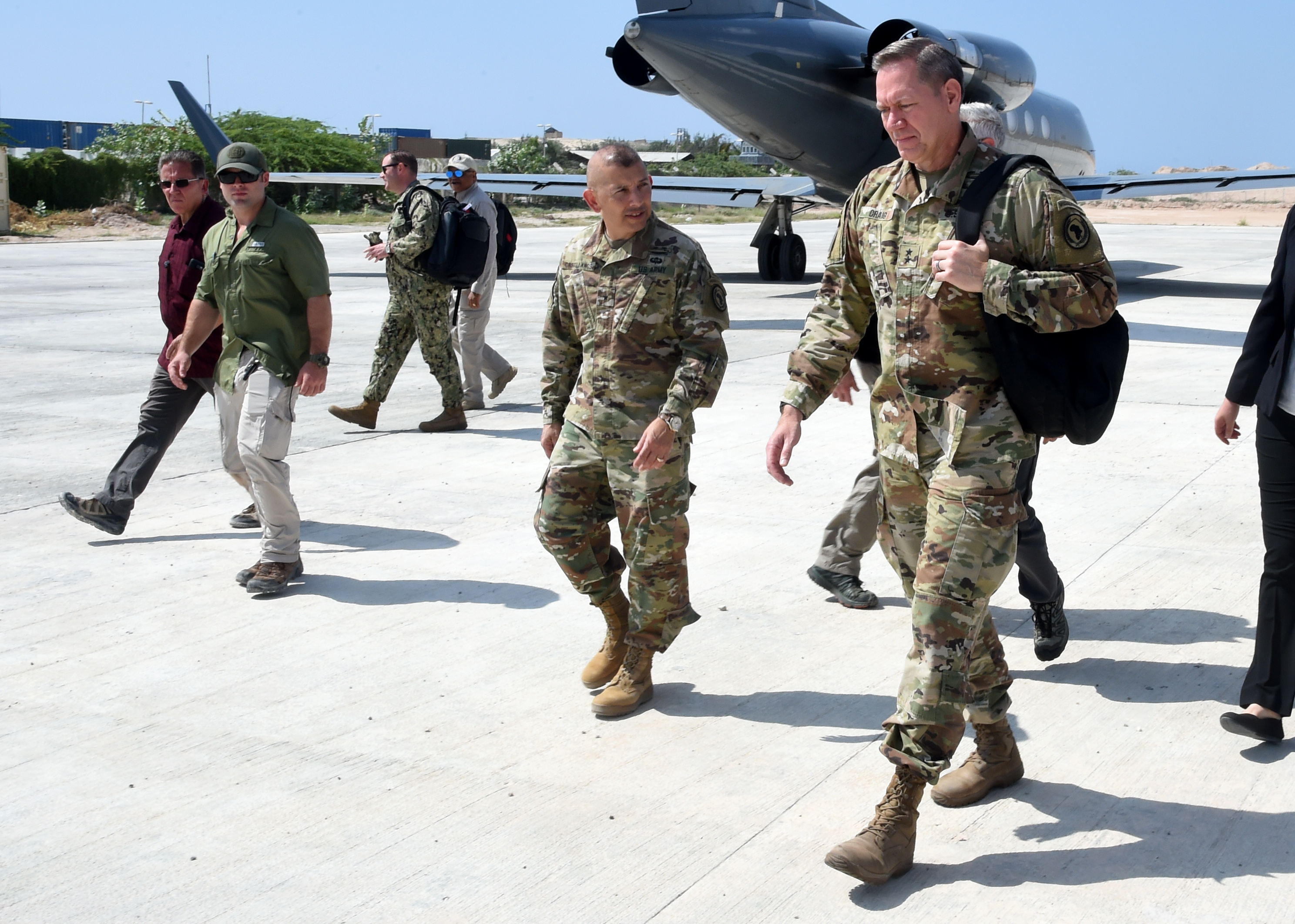MOGADISHU, Somalia – U.S. Army Major Gen. James D. Craig, commanding general, Combined Joint Task Force–Horn of Africa, walks on the flight line at Aden Adde International Airport in Mogadishu, Somalia Nov. 27, 2018. During his visit to Mogadishu Craig also met with Somali President Mohamed Abdullahi Mohamed, and Marine Gen. Thomas D. Waldhauser, commanding general, U.S. Africa Command, to discuss development, security and stability in Somalia. 