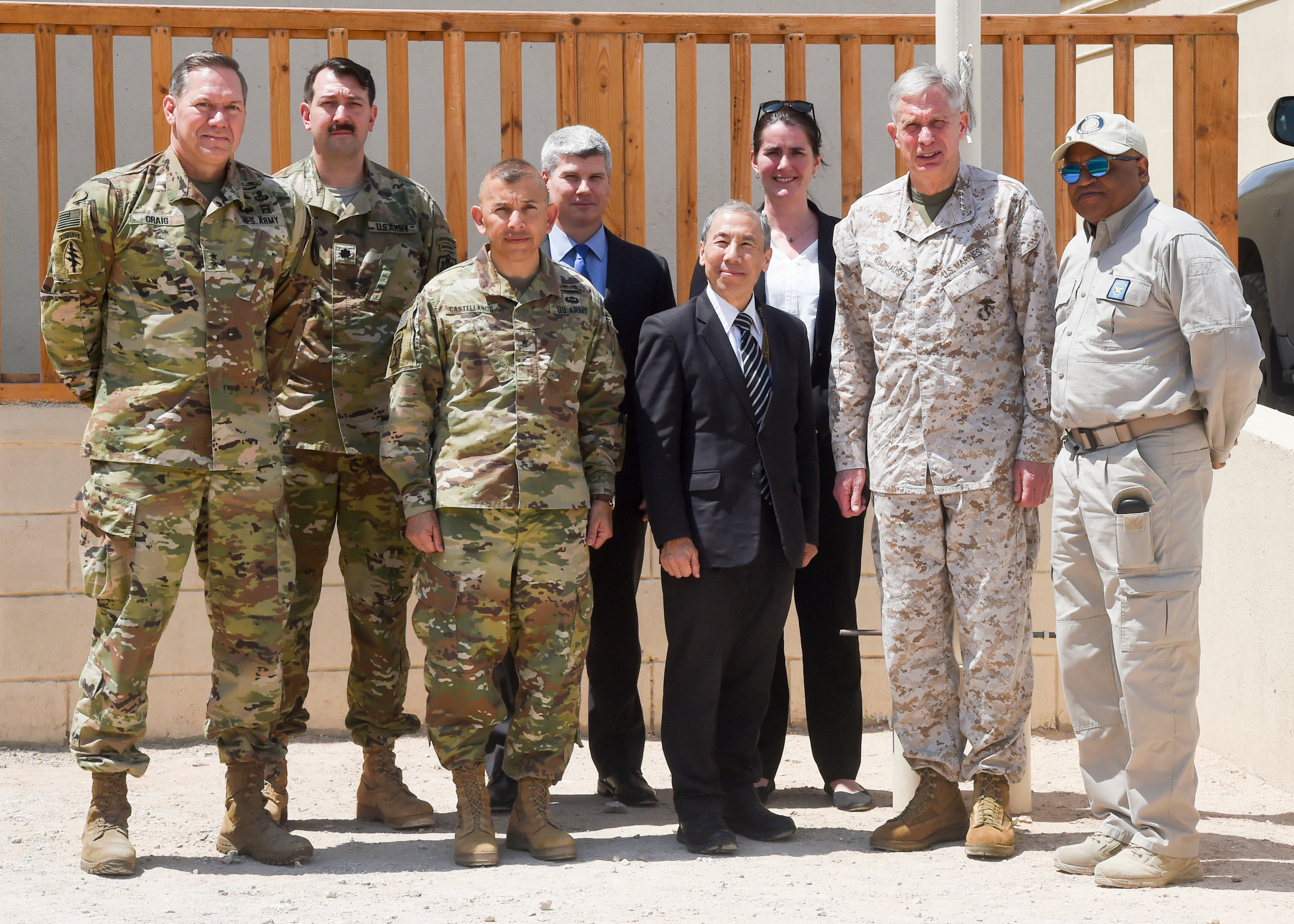 MOGADISHU, Somalia – U.S. Marine Gen. Thomas D. Waldhauser (right), commanding general, U.S. Africa Command,  U.S. Ambassador to Somalia Donald Yamamoto (center), and U.S. Army Major Gen. James D. Craig (left), commanding general, Combined Joint Task Force–Horn of Africa, pose for a photo with officers and U.S. officials in Mogadishu, Somalia Nov. 27, 2018. During his visit to Mogadishu Waldhauser also met with Somali President Mohamed Abdullahi Mohamed to discuss development, security and stability in Somalia. 