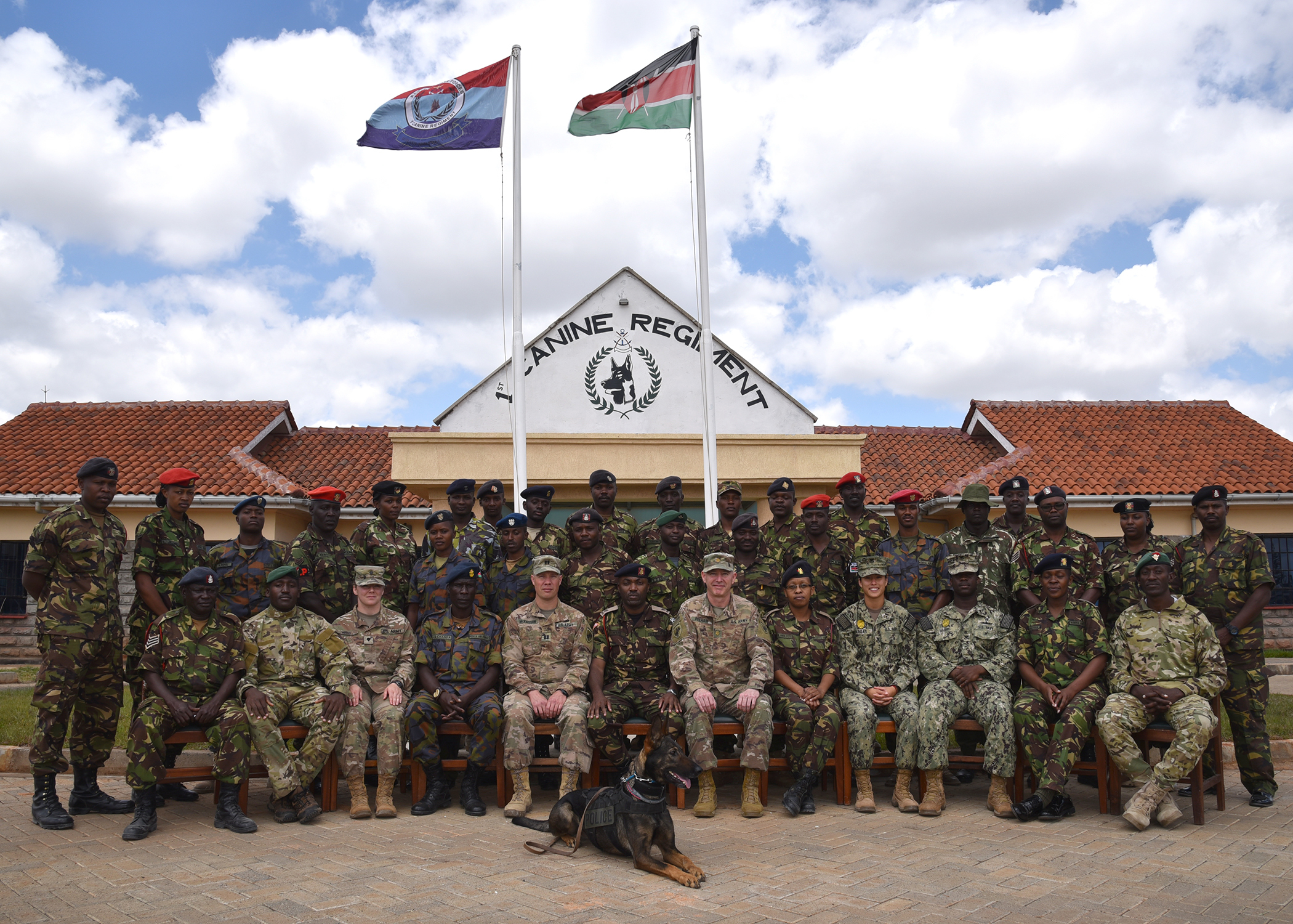 Veterinarians from the U.S. Army's 403rd Civil Affairs Battalion's Functional Specialty Team, assigned to Combined Joint Task Force-Horn of Africa, and U.S. Navy military working dog handlers, both from Camp Lemonnier, Djibouti, pose for a photo with members of the Kenya Defence Force (KDF) 1st Canine Regiment in Nairobi, Kenya, Nov. 23, 2018. The U.S. subject matter experts visited the Kenyan handlers and veterinarians to share best practices in their field. (U.S. Air Force photo by Senior Airman Kirsten Brandes)