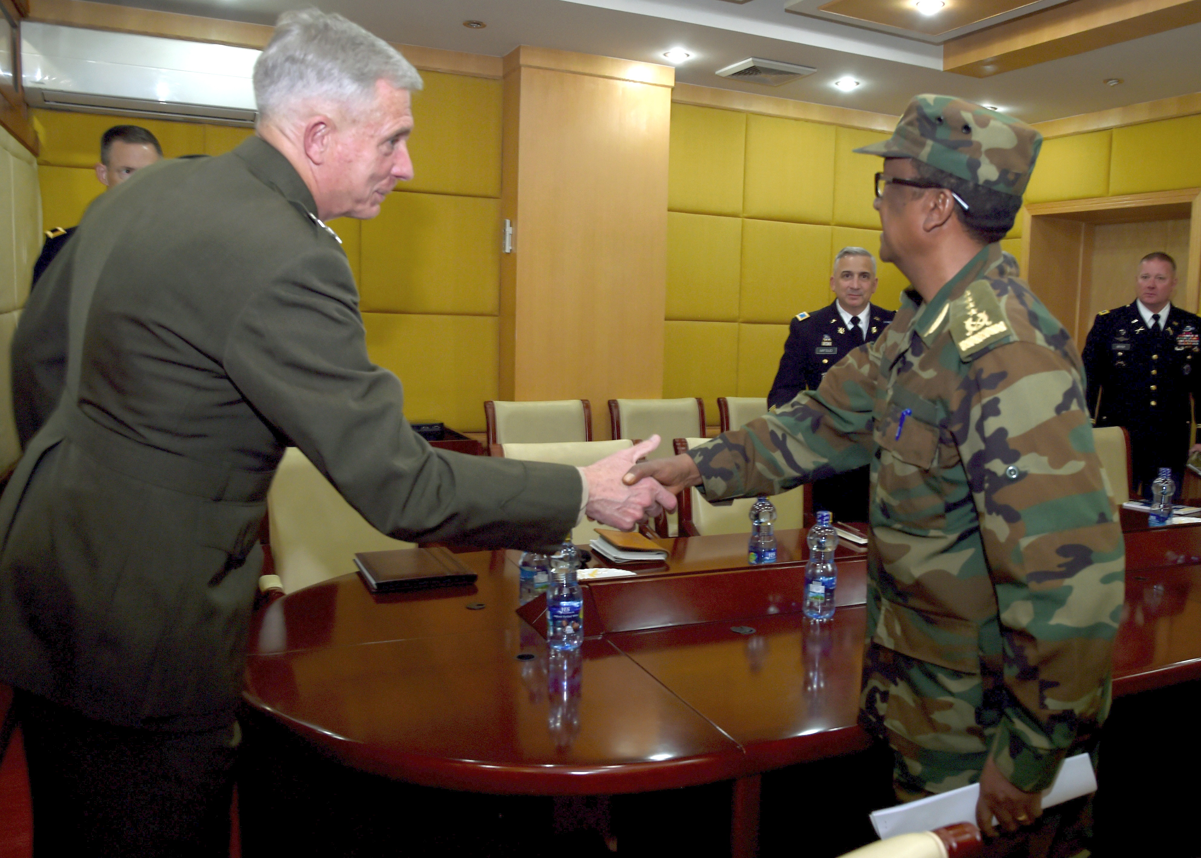 ADDIS ABABA, Ethiopia – U.S. Marine Gen. Thomas D. Waldhauser, Commander, U.S. Africa Command, shakes hands with Ethiopian Gen. Birhanu Jula, Deputy Chief of General Staff for the Ministry of Defense for Ethiopia at a meeting in Addis Ababa, Ethiopia November 28. During his visit to Addis Ababa, Waldhauser also met with Ethiopian Minister of Defense Aisha Mohammed, U.S. Ambassador to Ethiopia Michael Raynor, and Assistant Secretary of State for the Bureau of African Affairs, Tibor P. Nagy. (U.S. Navy Photo by Mass Communication Specialist 1st Class Nick Scott)