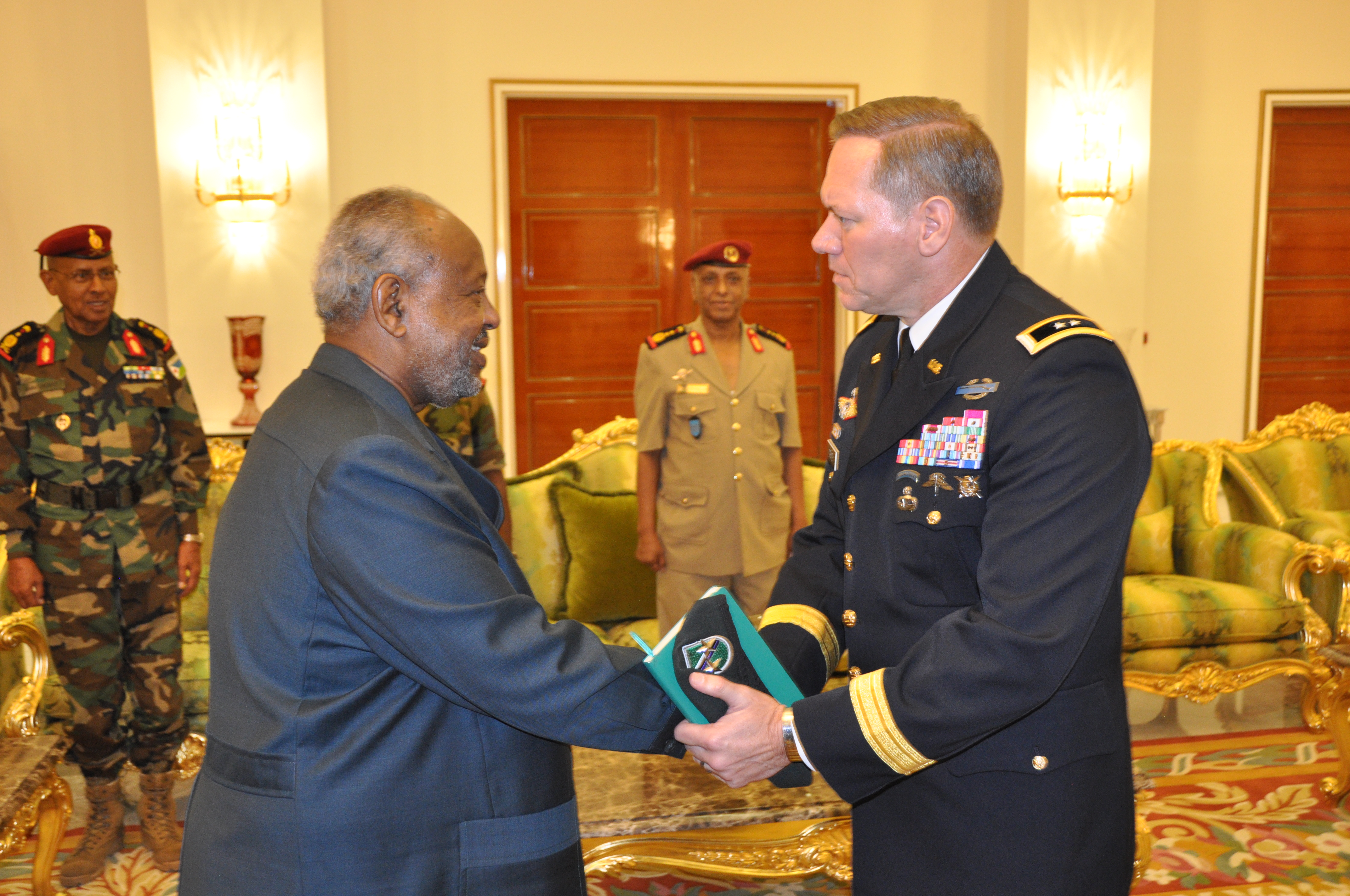 "DJIBOUTI CITY, Djibouti—U.S. Army Maj. Gen. James Craig, commander, Combined Joint Task Force Horn of Africa, shakes hands with Djiboutian President Ismail Omar Guelleh, on Nov. 29, 2018, in Djibouti City, Djibouti, during a visit conducted by him and U.S. Marine Gen. Thomas D. Waldhauser, commander of United States Africa Command (AFRICOM). ""We have a strong, cooperative relationship with the Republic of Djibouti,"" said Waldhauser, ""and we view security and access to Djibouti as a top priority.""