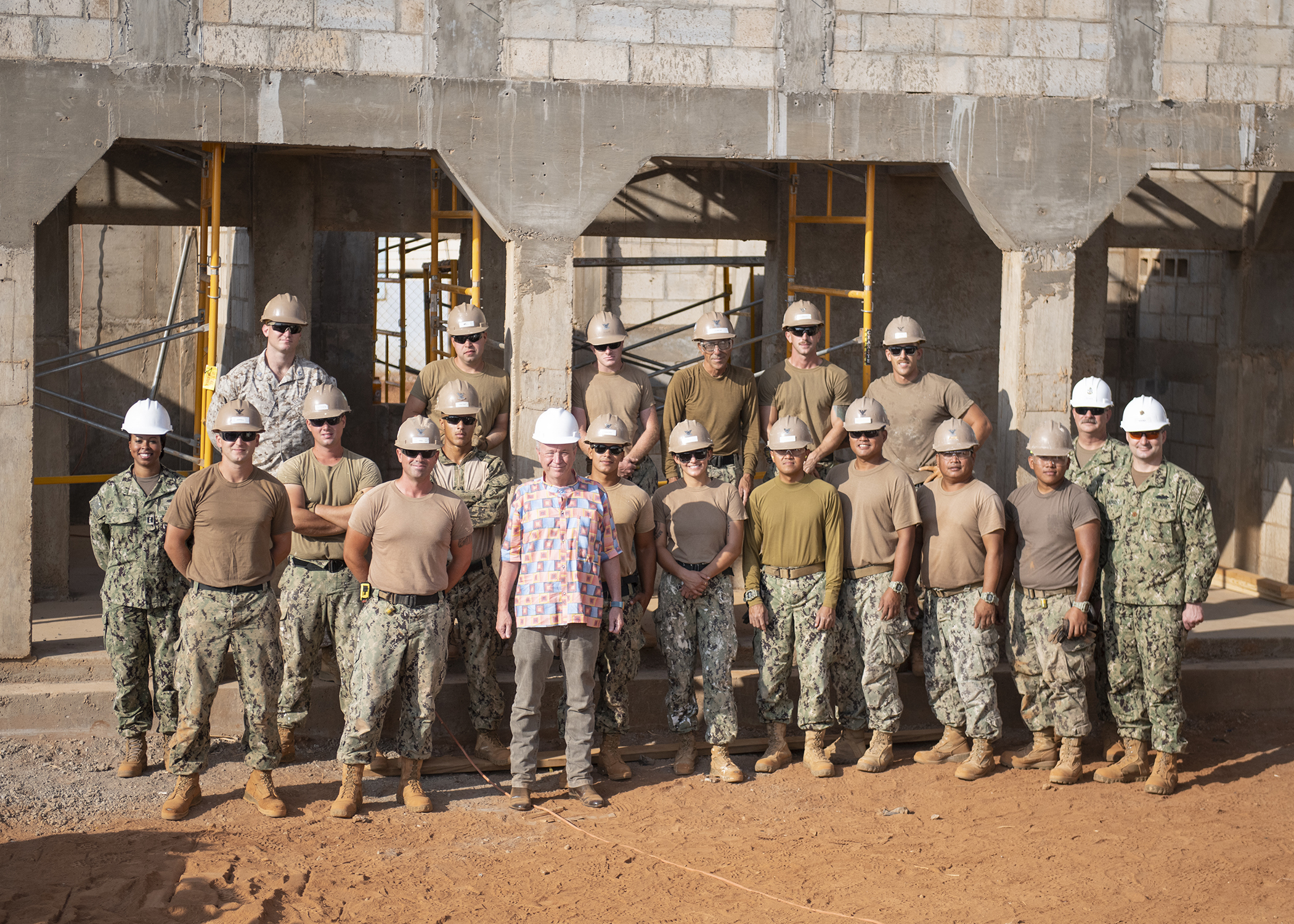 Amb. Larry André Jr., U.S. Ambassador to the Republic of Djibouti, poses for a photo with U.S. Navy Sailors from Naval Mobile Construction Battalions 1 and 18, assigned to Combined Joint Task Force-Horn of Africa, Camp Lemonnier, Djibouti, during a visit to the construction site of the future Ali Oune, Djibouti, Women's Medical Clinic, Dec. 3, 2018. Slated for completion by January 2019, the clinic is intended to enhance the Ministry of Health for Djibouti's ability to provide basic medical, birth and after care to the Ali Oune village and its more than 1,000 residents and rural neighbors. (U.S. Air Force photo by Tech. Sgt. Shawn Nickel)