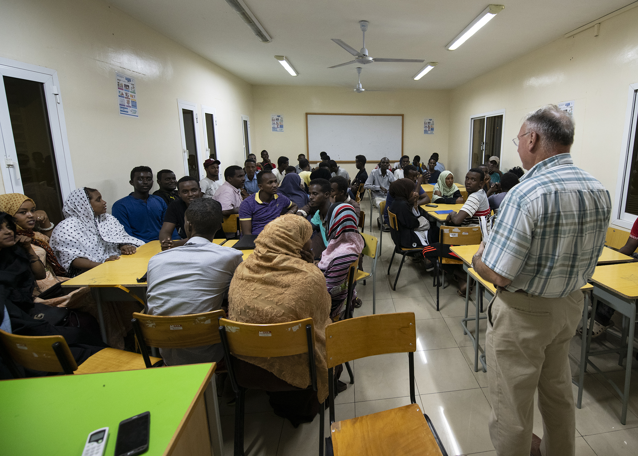 "U.S. Army Capt. Michael Volk, a civil affairs officer, 403rd Civil Affairs Battalion, Combined Joint Task Force-Horn of Africa, Camp Lemonnier, Djibouti, gives opening remarks during the first-ever English Discussion Group (EDG) in the neighborhood of Balbala, with more than 40 Djiboutian students Nov. 29, 2018. The EDG serves as a ""language laboratory"" in which students develop practical linguistic and rhetorical skills through relationship building and information exchange. (U.S. Air Force photo by Tech. Sgt. Shawn Nickel)"