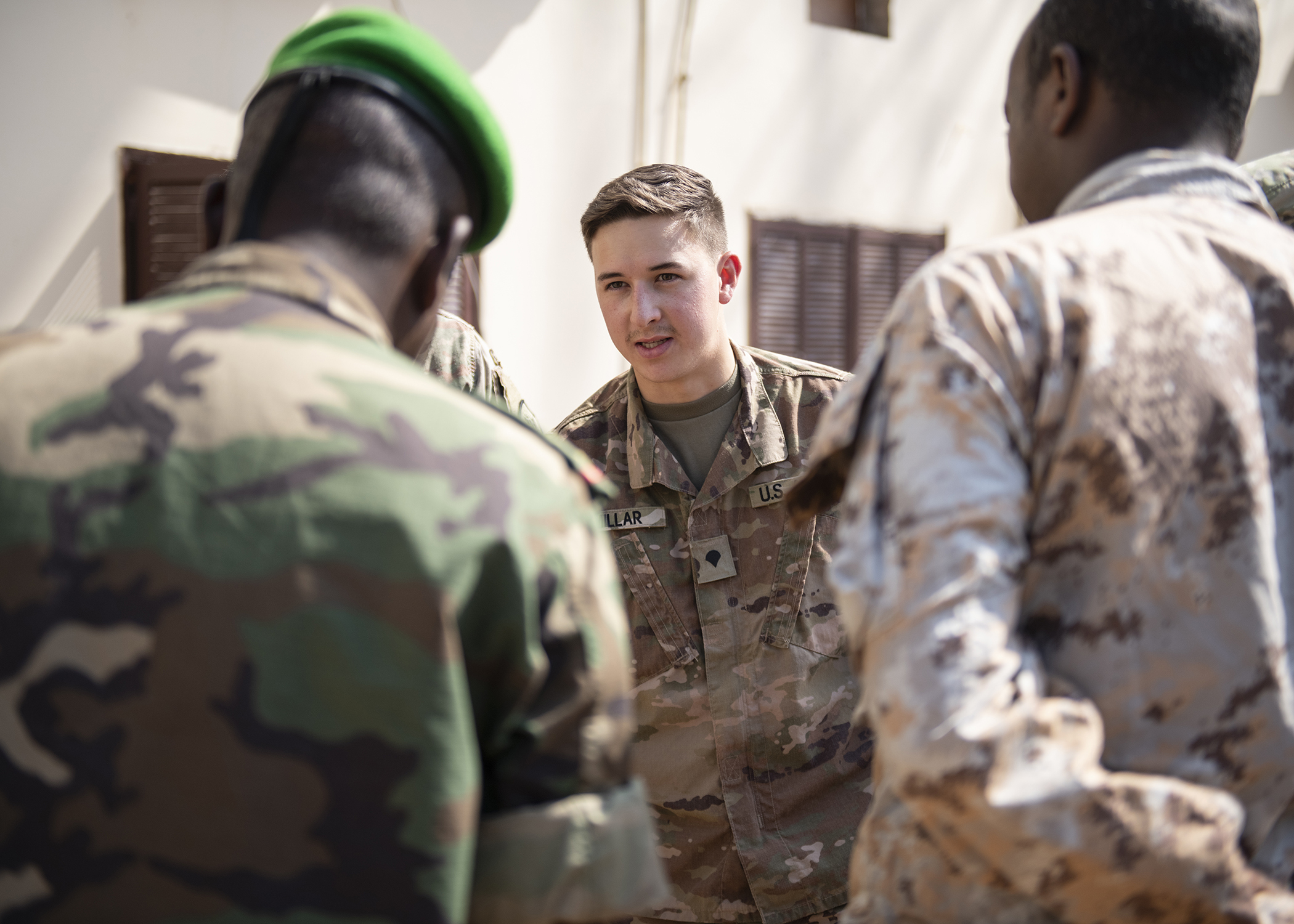 U.S. Army Spc. Bretton Millar, assigned to the Combined Joint Task Force-Horn of Africa communications directorate, explains the importance of leveling a satellite unit during an Africa Data Sharing Network (ADSN), version two, information exchange with Djibouti Army (FAD) soldiers at FAD Headquarters, Djibouti, Dec. 26, 2018. The ADSN works as an internal network that the African Union Mission in Somalia troop-contributing countries can use to communicate and share information amongst each other. (U.S. Air Force photo by Tech. Sgt. Shawn Nickel)