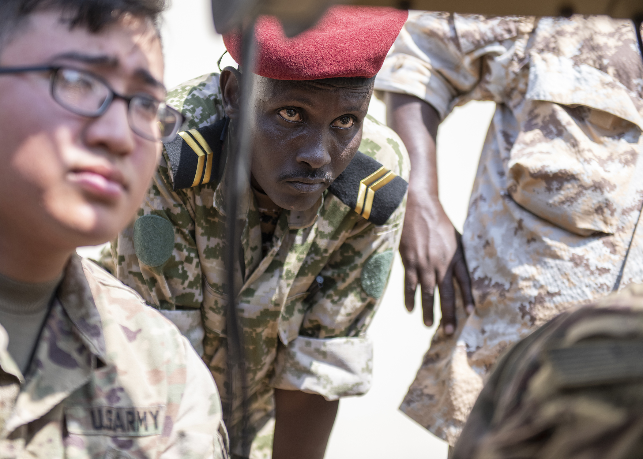 A Djibouti Army (FAD) soldier watches while U.S. Army Soldiers from the Combined Joint Task Force-Horn of Africa communications directorate set up a satellite unit during an Africa Data Sharing Network (ADSN), version two, information exchange with FAD soldiers at FAD Headquarters, Djibouti, Dec. 26, 2018. The ADSN works as an internal network that the African Union Mission in Somalia troop-contributing countries can use to communicate and share information amongst each other. (U.S. Air Force photo by Tech. Sgt. Shawn Nickel)