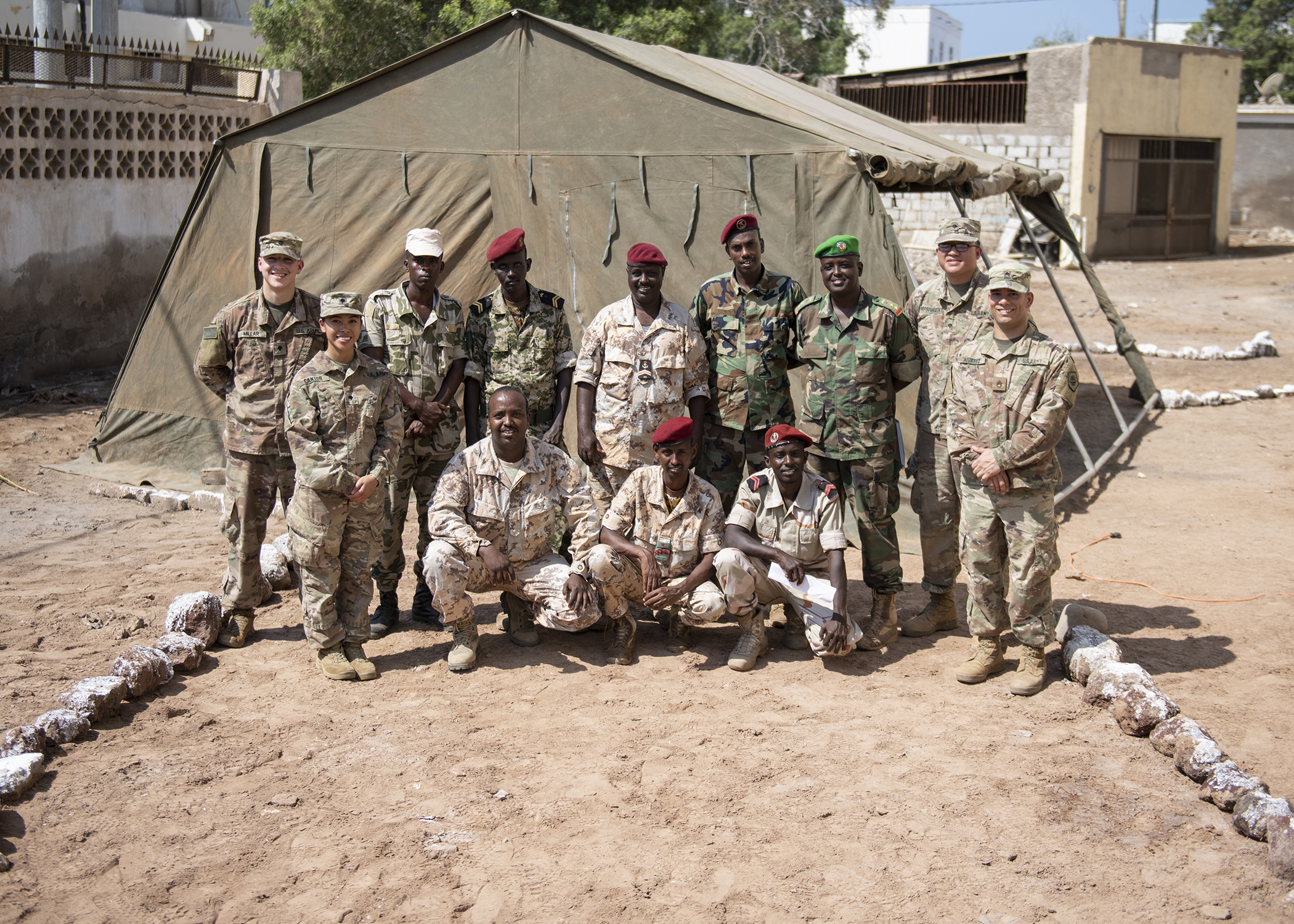 Djibouti Army (FAD) soldiers pose with U.S. Army Soldiers from the Combined Joint Task Force-Horn of Africa communications directorate, after working together to set up a satellite unit during an Africa Data Sharing Network (ADSN), version two, information exchange with FAD soldiers at FAD Headquarters, Djibouti, Dec. 26, 2018. The ADSN works as an internal network that the African Union Mission in Somalia troop-contributing countries can use to communicate and share information amongst each other. (U.S. Air Force photo by Tech. Sgt. Shawn Nickel)
