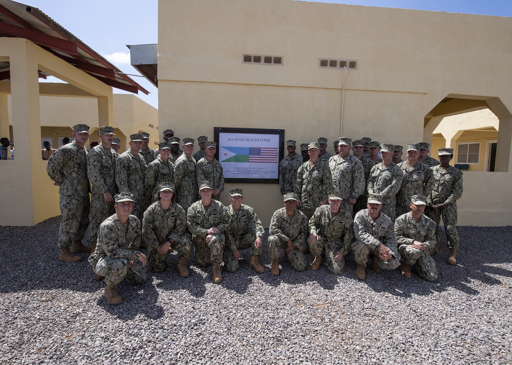 U.S. Navy Seabees from Naval Mobile Construction Battalion 1, assigned to Combined Joint Task Force-Horn of Africa, pose for a group photo during the Ali Oune Medial Clinic ribbon cutting ceremony in Ali Oune, Djibouti, Jan. 31, 2019. The clinic, which the Seabees have worked on for five months, is intended to enhance the Ministry of Health for Djibouti's ability to provide basic medical, birth and after care to the Ali Oune village and its more than 1,000 residents and rural neighbors. (U.S. Air Force photo by Tech. Sgt. Shawn Nickel)