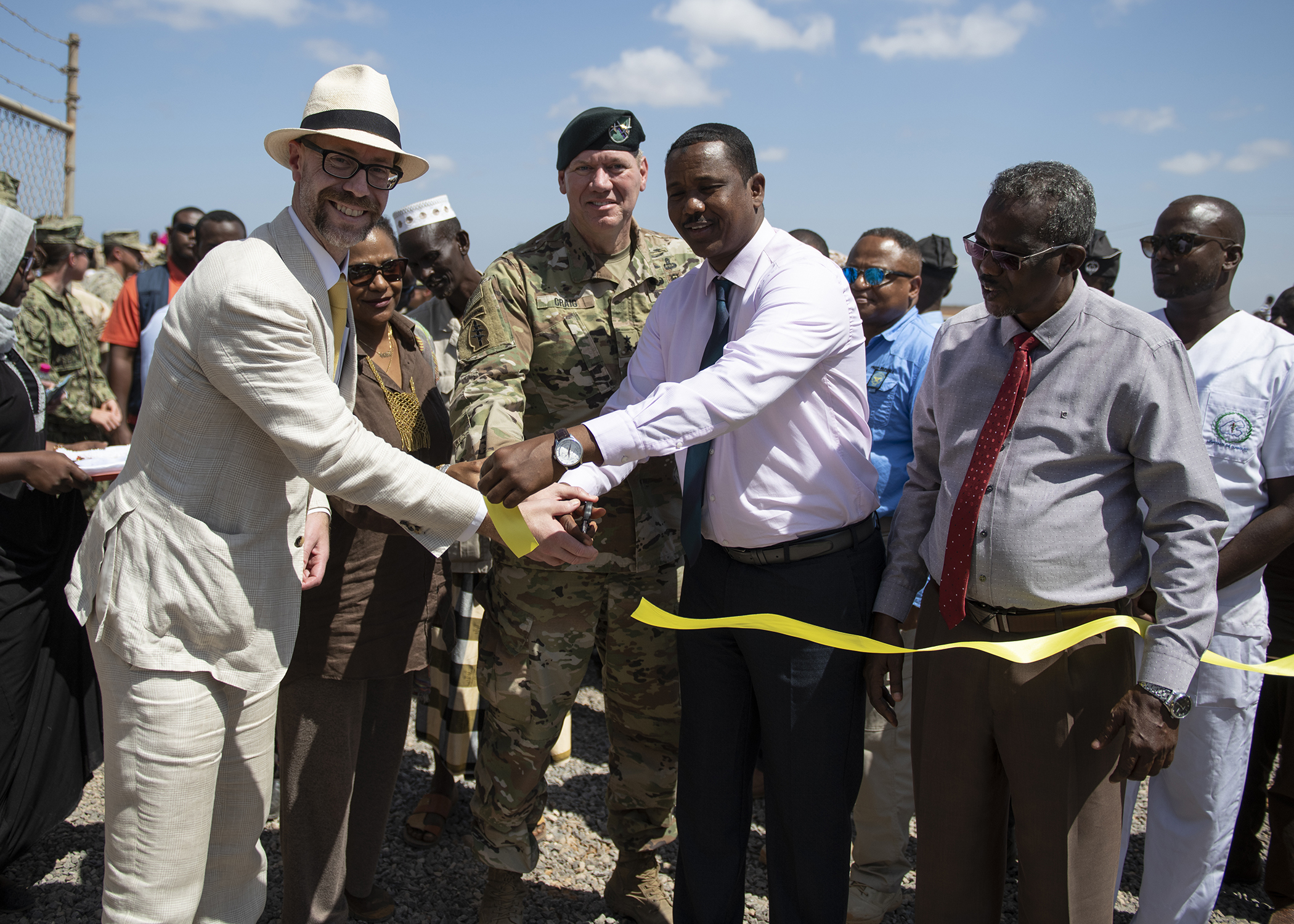 U.S. Djibouti Embassy officials, Combined Joint Task Force-Horn of Africa leadership, and Djiboutian government leaders cut the ribbon for the Ali Oune Medial Clinic during a ceremony in Ali Oune, Djibouti, Jan. 31, 2019. The clinic, which U.S. Navy Seabees from Naval Mobile Construction Battalion 1, assigned to CJTF-HOA, have been working to complete for five months, is intended to enhance the Ministry of Health for Djibouti's ability to provide basic medical, birth and after care to the Ali Oune village and its more than 1,000 residents and rural neighbors. (U.S. Air Force photo by Tech. Sgt. Shawn Nickel)