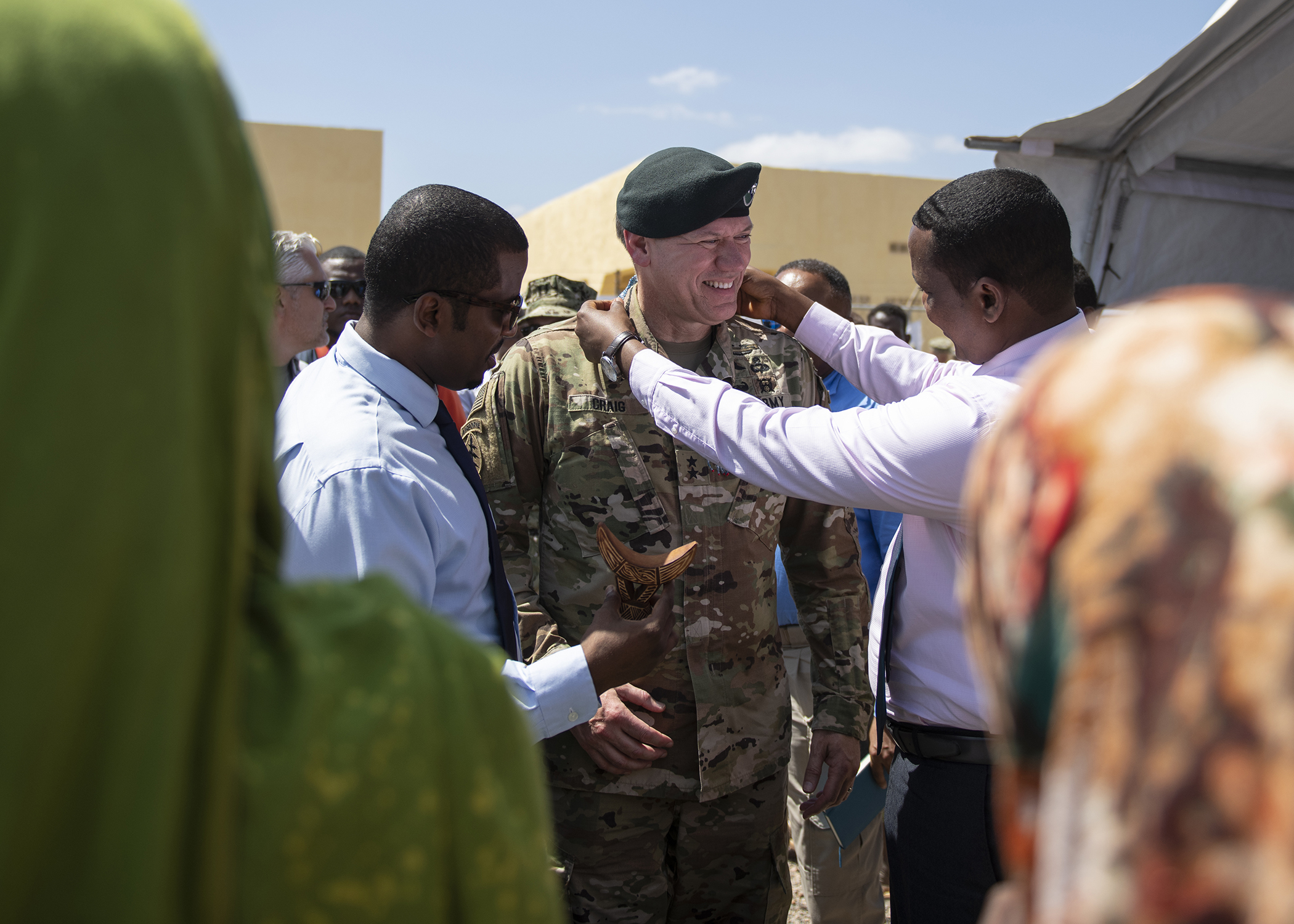 U.S. Army Maj. Gen. James D. Craig, commanding general, Combined Joint Task Force-Horn of Africa (CJTF-HOA), receives a gift from Djiboutian government officials during the Ali Oune Medial Clinic ribbon cutting ceremony in Ali Oune, Djibouti, Jan. 31, 2019. The clinic, which U.S. Navy Seabees from Naval Mobile Construction Battalion 1, assigned to CJTF-HOA, have been working to complete for five months, is intended to enhance the Ministry of Health for Djibouti's ability to provide basic medical, birth and after care to the Ali Oune village and its more than 1,000 residents and rural neighbors. (U.S. Air Force photo by Tech. Sgt. Shawn Nickel)