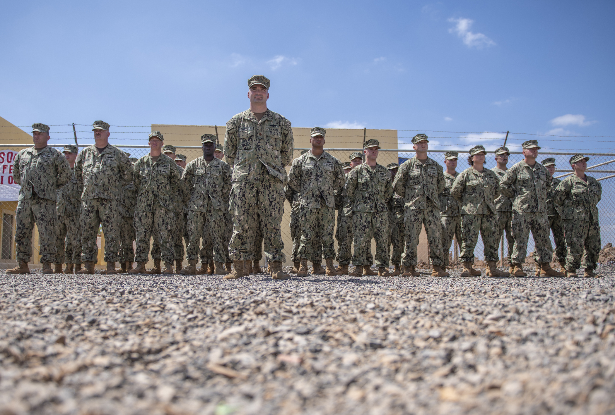 U.S. Navy Seabees from Naval Mobile Construction Battalion 1, assigned to Combined Joint Task Force-Horn of Africa, stand in formation during the Ali Oune Medial Clinic ribbon cutting ceremony in Ali Oune, Djibouti, Jan. 31, 2019. The clinic, which the Seabees have worked on for five months, is intended to enhance the Ministry of Health for Djibouti's ability to provide basic medical, birth and after care to the Ali Oune village and its more than 1,000 residents and rural neighbors. (U.S. Air Force photo by Tech. Sgt. Shawn Nickel)