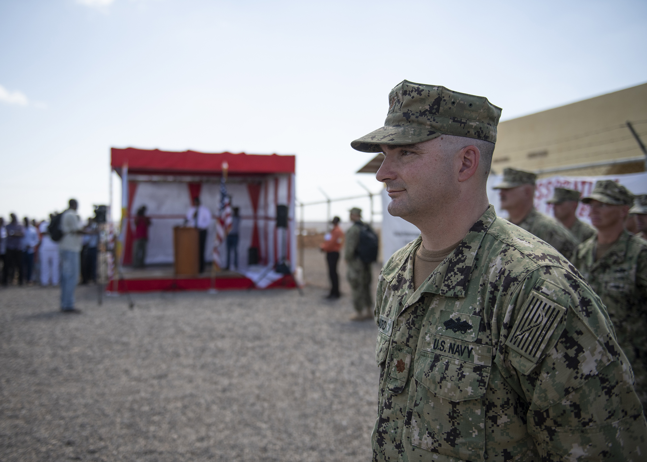 U.S. Navy Seabee Lt. Cmdr. Matthew Baird, detail officer in charge, Naval Mobile Construction Battalion 1, assigned to Combined Joint Task Force-Horn of Africa (CJTF-HOA), leads a formation during the Ali Oune Medial Clinic ribbon cutting ceremony in Ali Oune, Djibouti, Jan. 31, 2019. The clinic, which the Seabees have worked on for five months, is intended to enhance the Ministry of Health for Djibouti's ability to provide basic medical, birth and after care to the Ali Oune village and its more than 1,000 residents and rural neighbors. (U.S. Air Force photo by Tech. Sgt. Shawn Nickel)