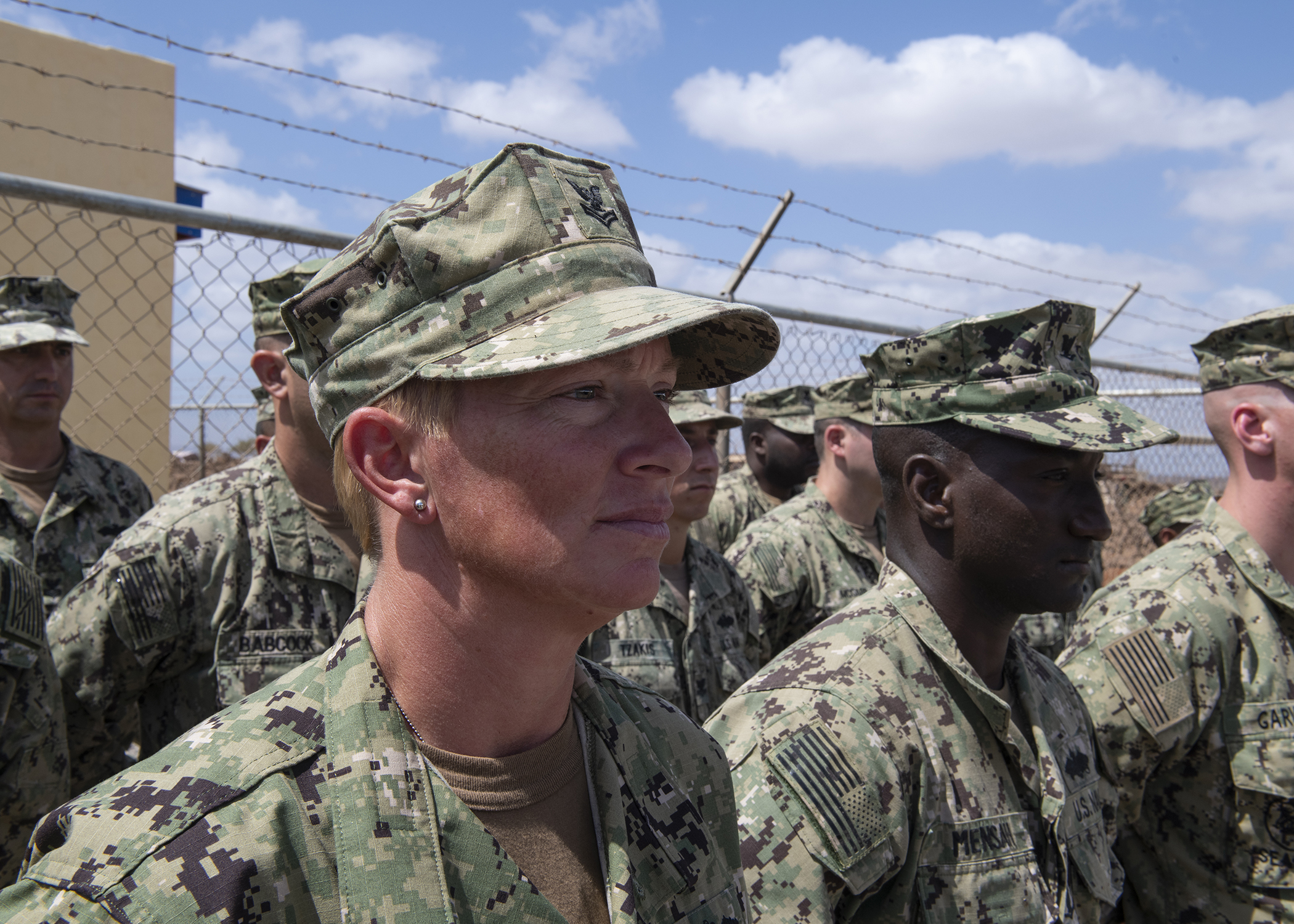 U.S. Navy Petty Officer 1st Class Carroll Bennett, a Seabee from Naval Mobile Construction Battalion 1, assigned to Combined Joint Task Force-Horn of Africa, stands in formation during the Ali Oune Medial Clinic ribbon cutting ceremony in Ali Oune, Djibouti, Jan. 31, 2019. The clinic, which the Seabees have worked on for five months, is intended to enhance the Ministry of Health for Djibouti's ability to provide basic medical, birth and after care to the Ali Oune village and its more than 1,000 residents and rural neighbors. (U.S. Air Force photo by Tech. Sgt. Shawn Nickel)