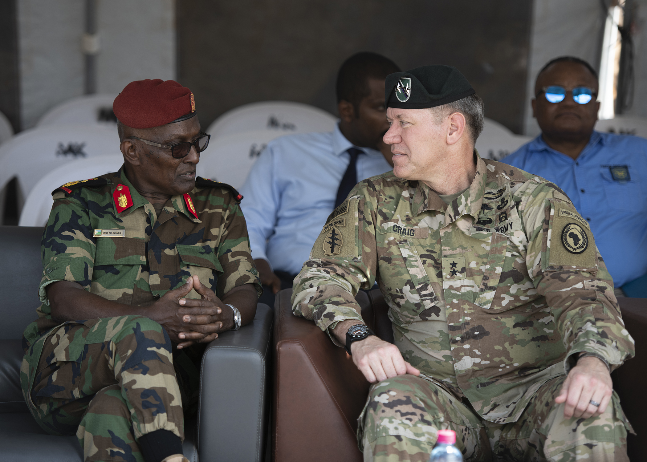 U.S. Army Maj. Gen. James D. Craig, commanding general, Combined Joint Task Force-Horn of Africa (CJTF-HOA), talks to a Djiboutian military officials during the Ali Oune Medial Clinic ribbon cutting ceremony in Ali Oune, Djibouti, Jan. 31, 2019. The clinic, which U.S. Navy Seabees from Naval Mobile Construction Battalion 1, assigned to CJTF-HOA, have been working to complete for five months, is intended to enhance the Ministry of Health for Djibouti's ability to provide basic medical, birth and after care to the Ali Oune village and its more than 1,000 residents and rural neighbors. (U.S. Air Force photo by Tech. Sgt. Shawn Nickel)