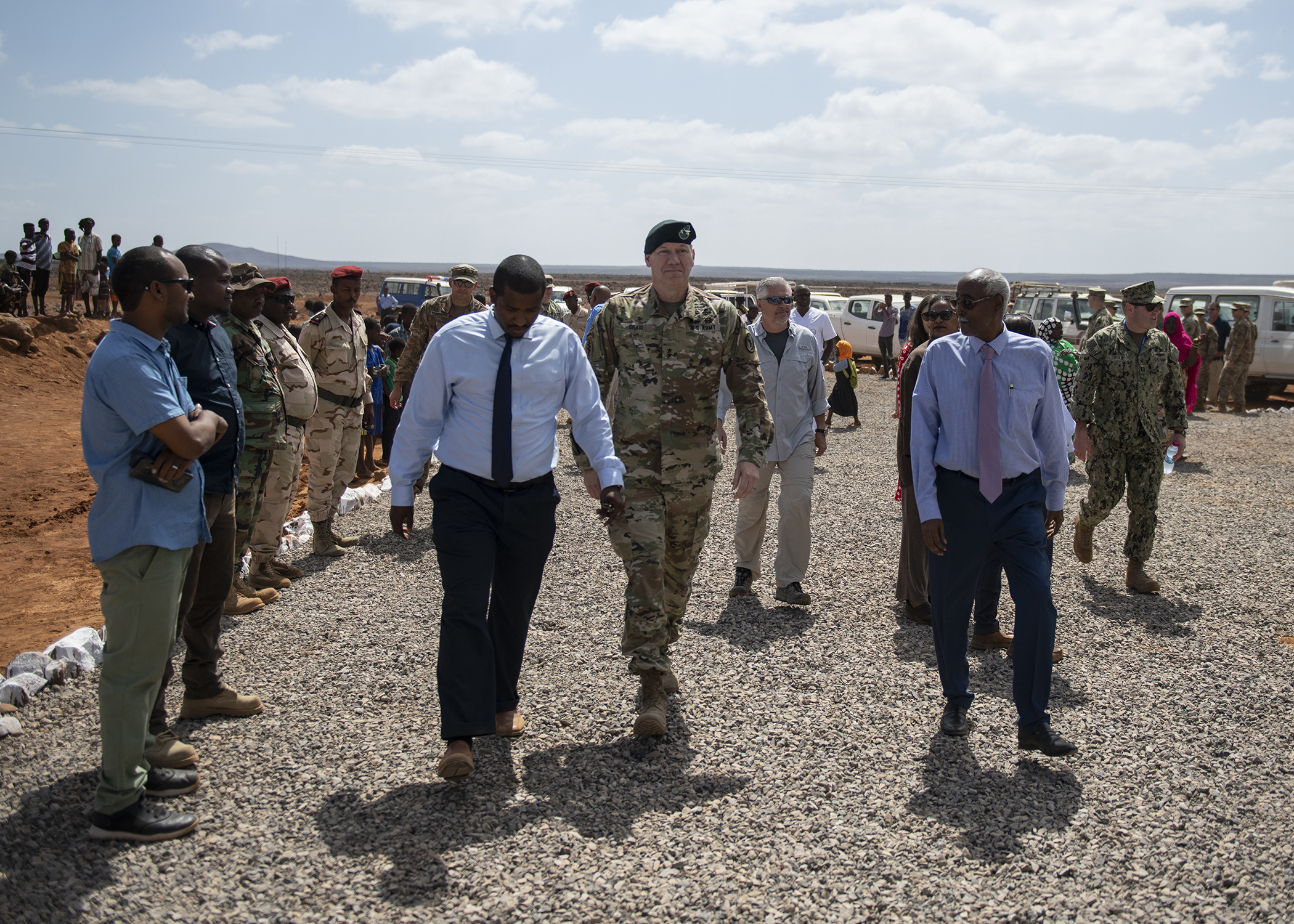 U.S. Army Maj. Gen. James D. Craig, commanding general, Combined Joint Task Force-Horn of Africa (CJTF-HOA), walks with Djiboutian government officials during the Ali Oune Medial Clinic ribbon cutting ceremony in Ali Oune, Djibouti, Jan. 31, 2019. The clinic, which U.S. Navy Seabees from Naval Mobile Construction Battalion 1, assigned to CJTF-HOA, have been working to complete for five months, is intended to enhance the Ministry of Health for Djibouti's ability to provide basic medical, birth and after care to the Ali Oune village and its more than 1,000 residents and rural neighbors. (U.S. Air Force photo by Tech. Sgt. Shawn Nickel)