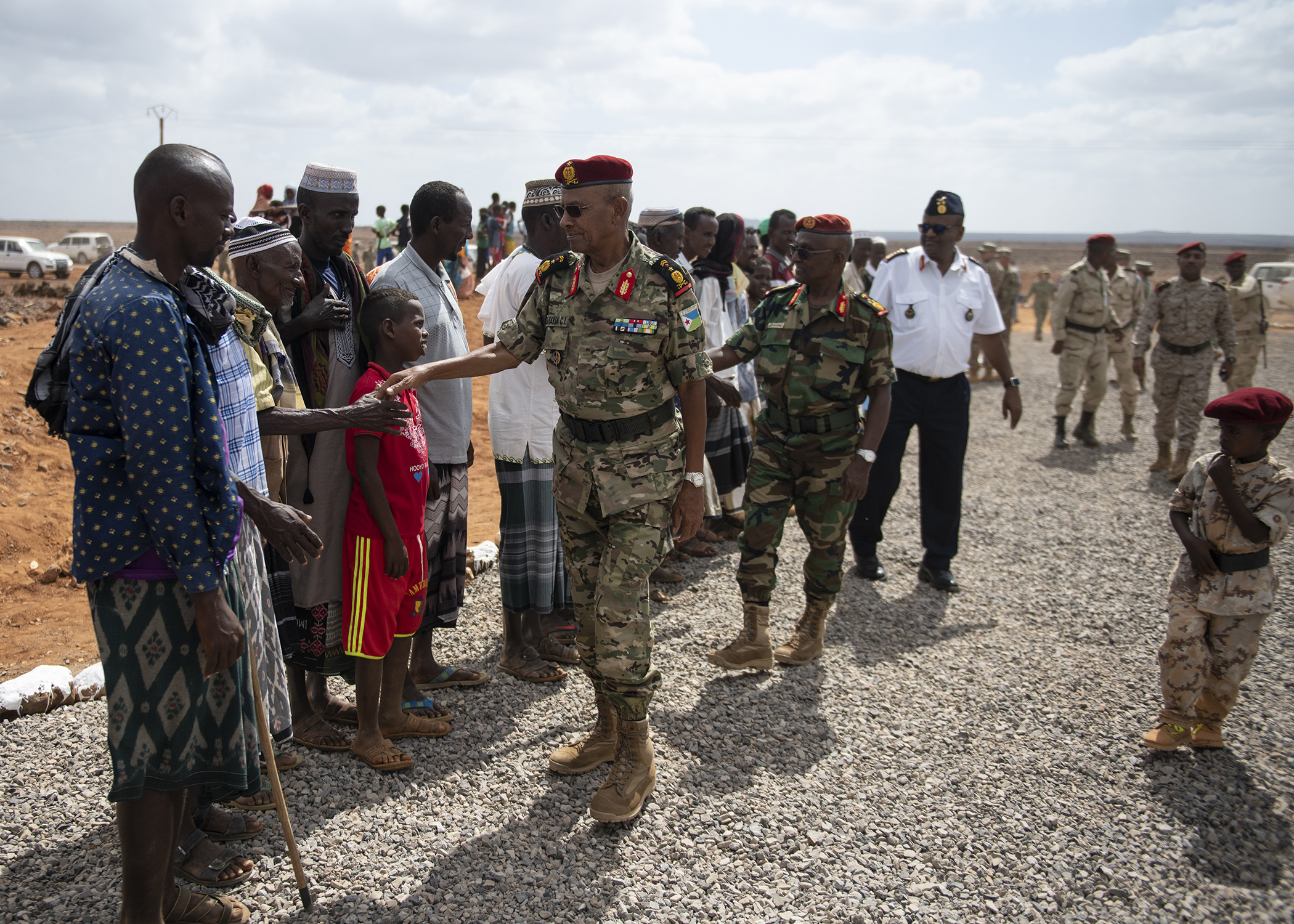 Djiboutian citizens greet military leaders during the Ali Oune Medial Clinic ribbon cutting ceremony in Ali Oune, Djibouti, Jan. 31, 2019. The clinic, which the U.S. Navy Seabees from Naval Mobile Construction Battalion 1, Combined Joint Task Force - Horn of Africa, have been working to complete for five months, is intended to enhance the Ministry of Health for Djibouti's ability to provide basic medical, birth and after care to the Ali Oune village and its more than 1,000 residents and rural neighbors. (U.S. Air Force photo by Tech. Sgt. Shawn Nickel)