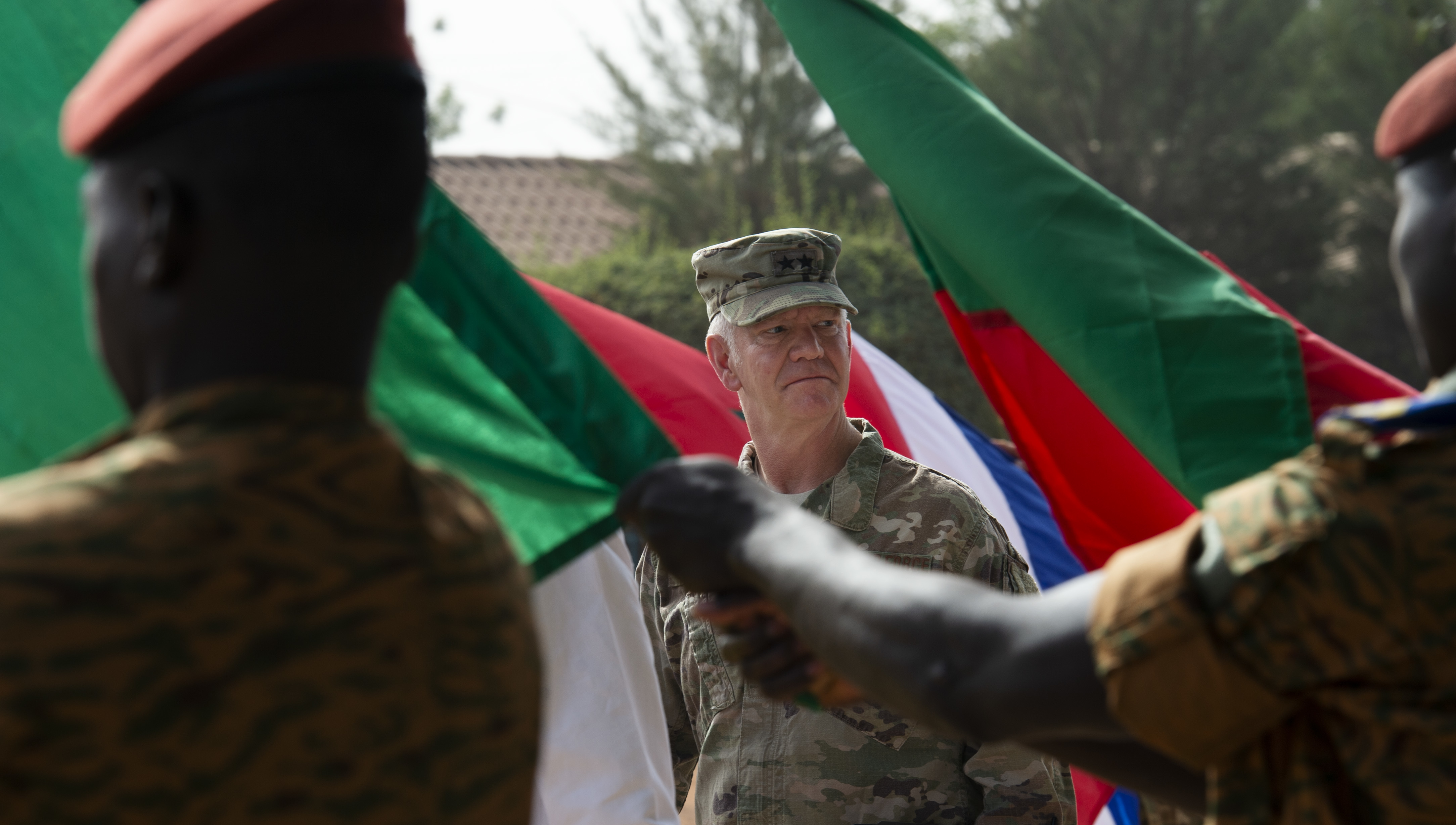 U.S. Air Force Maj. Gen. Mark Hicks, commander, Special Operations Command Africa, inspects service members from participating nations during a pass and review portion of the opening ceremony to Flintlock 2019. This year's exercise is being hosted by Burkina Faso with a key outstation in Mauritania.   (U.S. Navy photo by MC2 (SW/AW) Evan Parker / released)