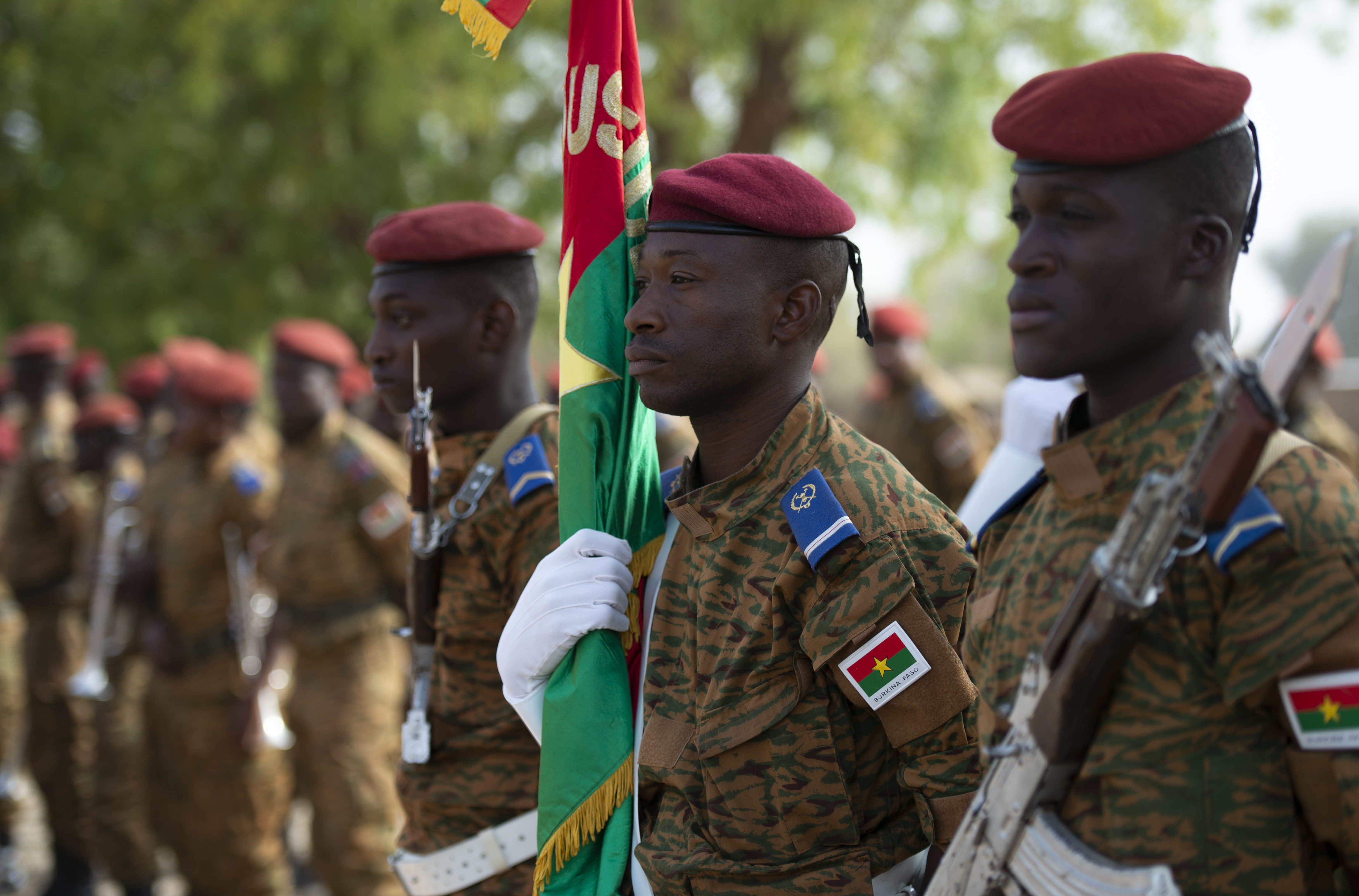 Members of the Burkinabe honor guard stand ready to be called to attention before the opening ceremony of Flintlock 2019, in Ouagadougou, Burkina Faso.  Flintlock is an annual African-led, integrated military and law enforcement exercise that has strengthened key partner nation forces throughout North and West Africa as well as western special operations forces since 2005. (U.S. Navy photo by MC2 (SW/AW) Evan Parker / released)