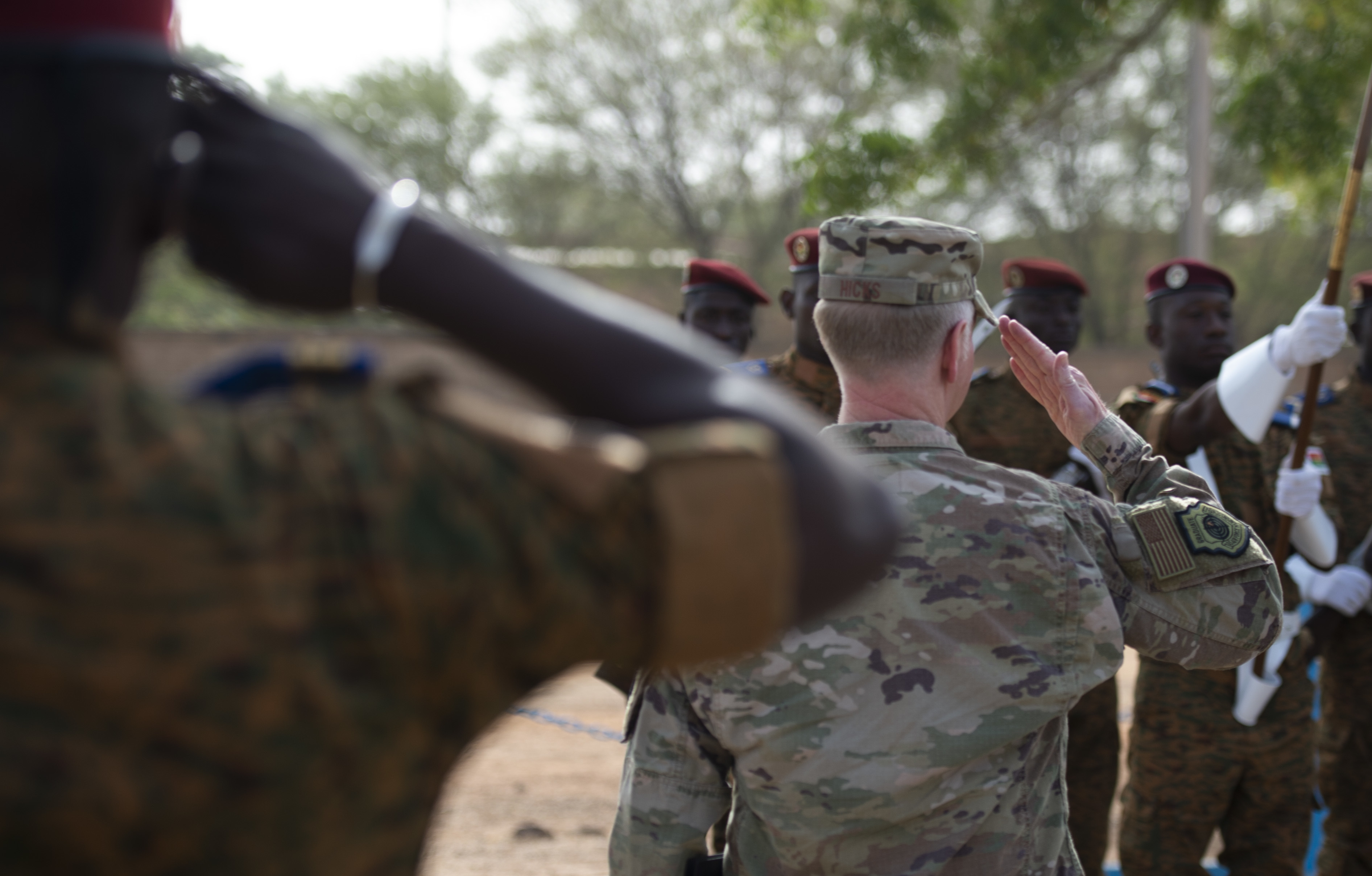 U.S. Air Force Maj. Gen. Mark Hicks, Commander, Special Operations Command Africa, renders honors during a pass and review portion of the opening ceremony to Flintlock 2019. Approximately 2,000 service members from more than 30 African and western partner nations are participating in Flintlock 2019 at multiple locations in Burkina Faso and a key outstation in Mauritania. (U.S. Navy photo by MC2 (SW/AW) Evan Parker / released)