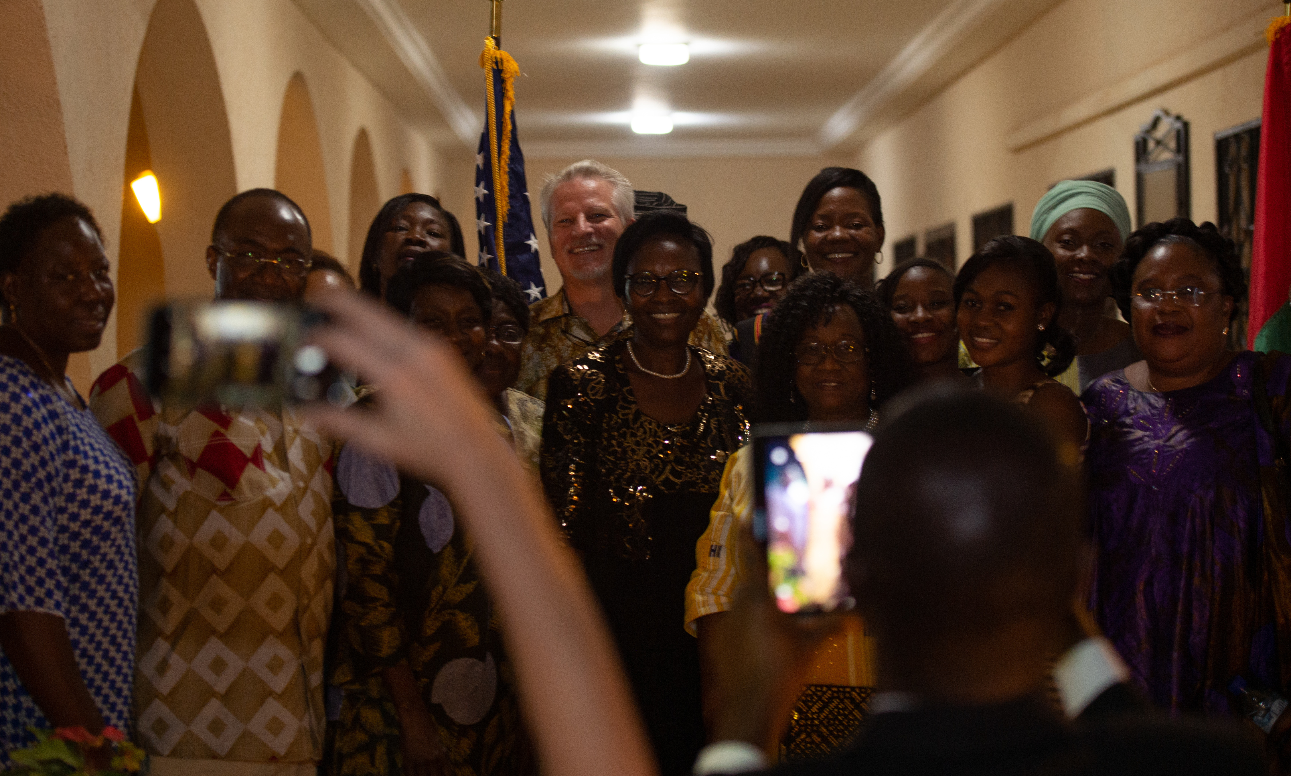 U.S. Ambassador to Burkina Faso, Andrew Young, takes a photo with attendees and guest speaker Dr. Justine Coulidiati-Kielem, regional coordinator for Women of the G5 Sahel Platform, at an embassy hosted Women, Peace, and Security Reception during the multi-national special operations exercise, Flintlock 2019 Feb 19.  Amb. Young stressed the importance of the vital and strategic roll women play in the development and stability of Africa's future. Flintlock 2019 better enables African and western partners to conduct real world missions structured around a coherent campaign plan and seamless integration. (U.S. Navy photo by MC2 (SW/AW) Evan Parker / released)