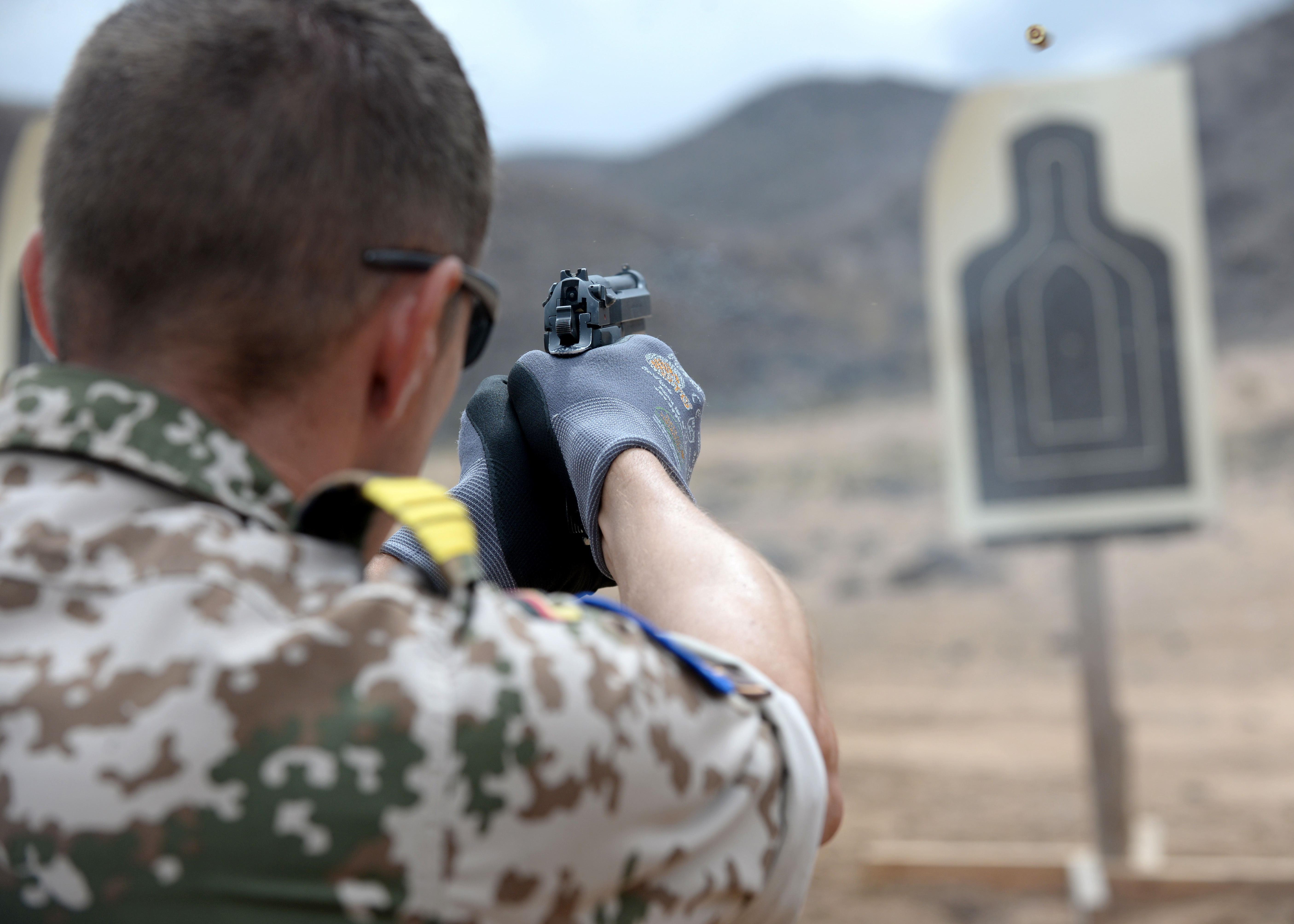 A Combined Joint Task Force-Horn of Africa foreign liaison officer from Germany fires a Beretta M9 pistol during weapons familiarization at the Djibouti Range Complex, Arta, Djibouti, Feb. 16, 2019. The course gave the foreign liaison officers an insight on the Beretta M9 pistol and stance techniques used by U.S. military members. (U.S. Air Force photo by Staff Sgt. Franklin R. Ramos)