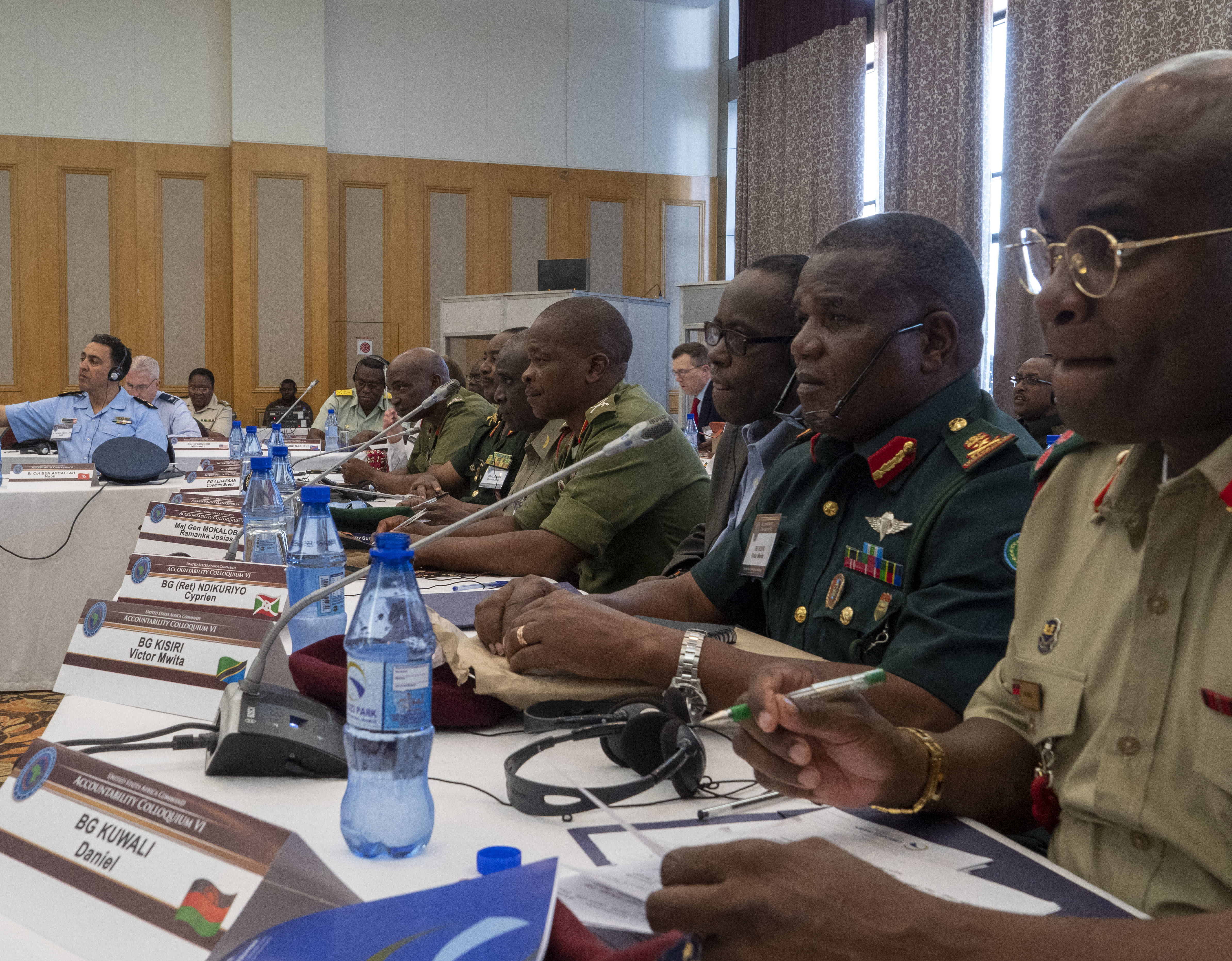 General Officer delegates to the Accountability Colloquium VI listen to a presentation being given in Lilongwe, Malawi, February 27, 2019. From right: Brigadier General Dan Kuwali, Malawi; Brigadier General Victor Mwita Kisiri, Tanzania; Brigadier General (Ret) Cyprien Ndikuriyo, Burundi; Major General Ramanka Josias Mokaloba, Lesotho; Brigadier General Sabino Jamba Machado, Angola; Brigadier General Cosmas Bretu Alhassan, Ghana; Brigadier General Posa Alphonce Stemere, Lesotho; (obscured) Brigadier General Mary Chaifullo, United States of America. (DoD Photo by U.S. Army Sergeant Edward A. Salcedo)