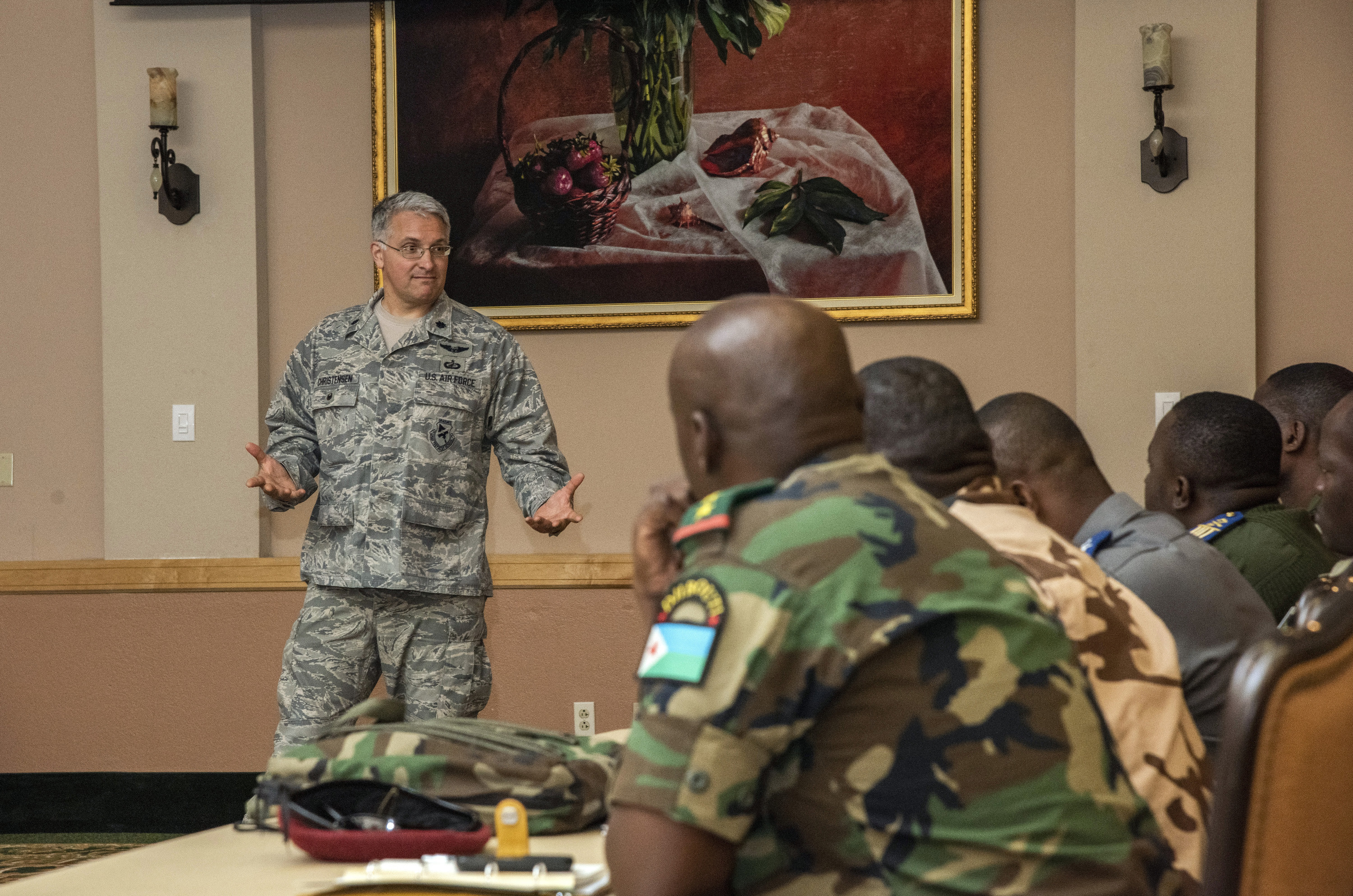 Lt. Col. Michael Christensen, an instructor at the Profession of Arms Center of Excellence, briefs a group of international offcers and senior non-commissioned officers on how to handle a vraiety of ethical dilemmas they may face as they manage people within a military organization. Introducing the participants to the programs that only the U.S. military has in place, such as the Equal Opportunity, Sexual Assault Prevention and Violence Prevention and providing them with the opportunity to think critically about how to handle situations in these areas was one aspect of thier five-day visit to U.S. Air Force and Army installations in the San Antonio area. (U.S. Air Force photo by Johnny Saldivar)