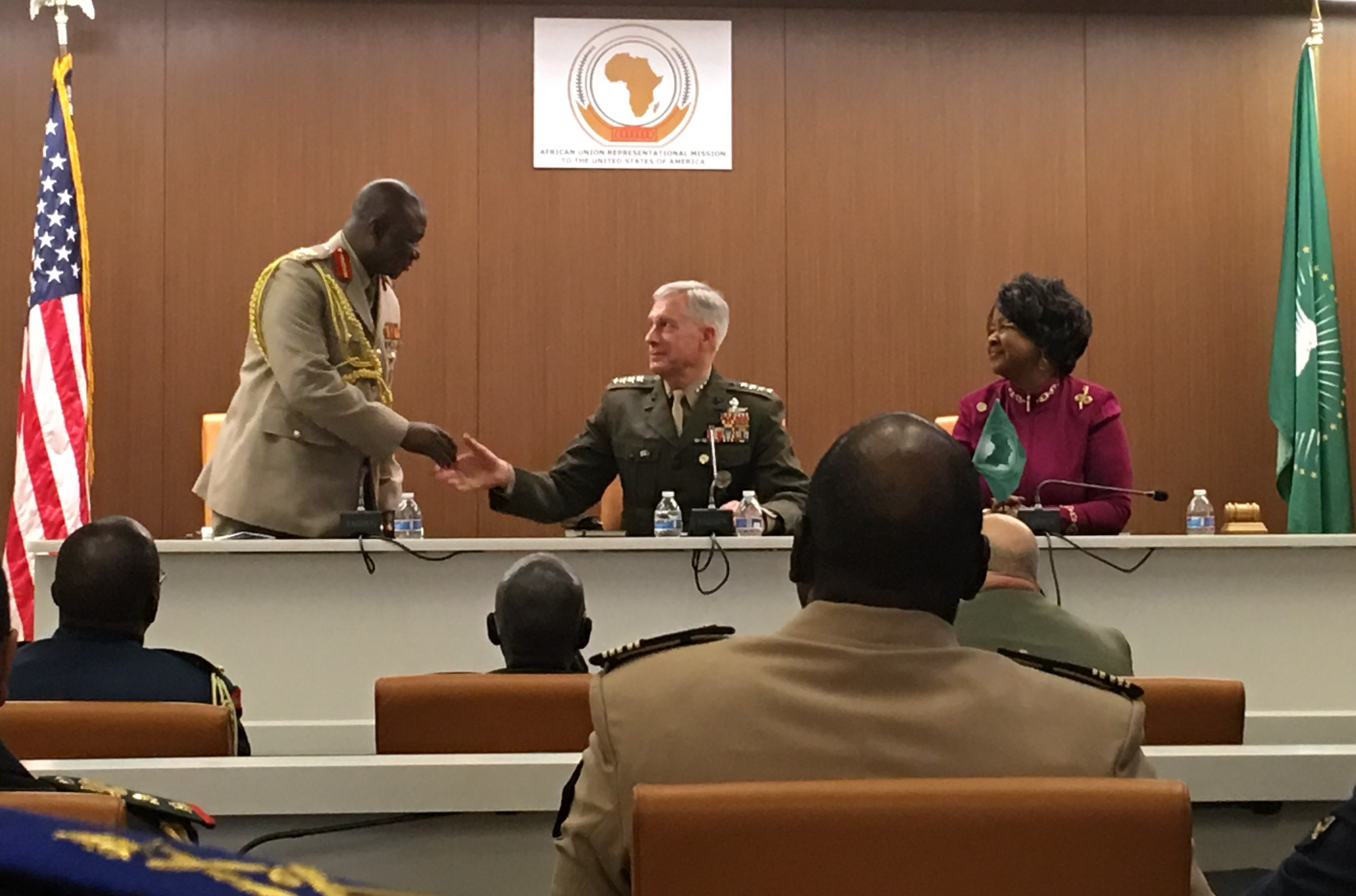 Marine Corps Gen. Thomas D. Waldhauser reaches out to shake the hand of Brig. Gen. Alhassan Abu, Military Navy Air Attaché, Ghana and Dean, African Defense Attaché Association, as the African Union Ambassador to the United States, Her Excellence Dr. Arikana Chihombori-Quao, looks on.  Waldhauser engaged with 21 defense attaches and the African Union Ambassador to the United States, in a wide-ranging discussion at the Africa House, in Washington D.C. Waldhauser stressed the importance of the U.S. relationship with African and efforts to build African partner capacity to address challenges on the continent.
