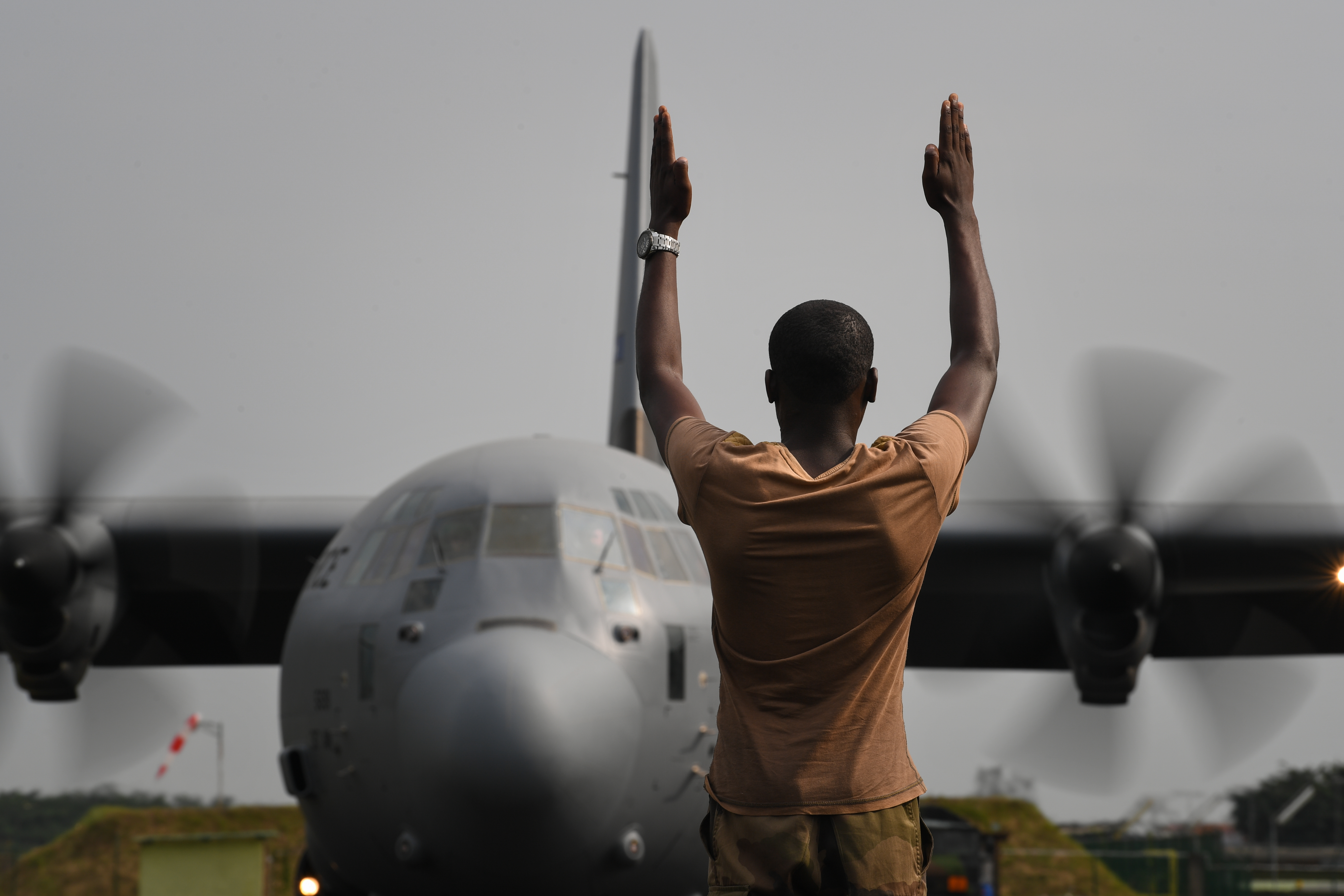 A U.S. Air Force C-130J Hercules assigned to the 75th Expeditionary Airlift Squadron, deployed in support of Combined Joint Task Force-Horn of Africa, lands in Libreville, Gabon, to resupply a cooperative security location, Jan. 22, 2019.  The 75th EAS supports Combined Joint Task Force - Horn of Africa (CJTF-HOA) with medical evacuations, disaster relief, humanitarian and airdrop operations. (U.S. Air Force photo by Staff Sgt. Corban Lundborg)