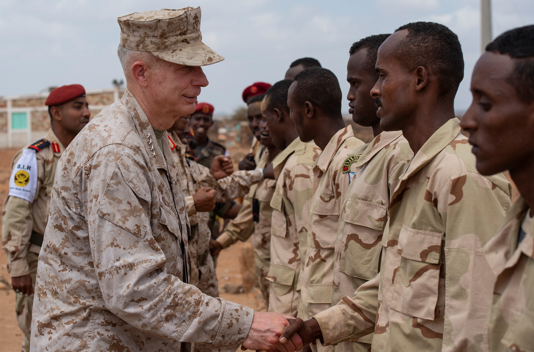 U.S. Marine Corps Gen. Thomas D. Waldhauser, commander of U.S. Africa Command, thanks soldiers from the Djiboutian army's elite military force, the Rapid Intervention Battalion, after demonstrating hand-to-hand combat during a visit with senior Djiboutian officials, including Chief of General Staff of the Djibouti Armed Forces Gen. Zakaria Cheikh Ibrahim, at a training base in Djibouti, March 21, 2019. Waldhauser visited in order to discuss the growth and development of Djiboutian security forces. (U.S. Air Force photo by Tech. Sgt. Shawn Nickel)