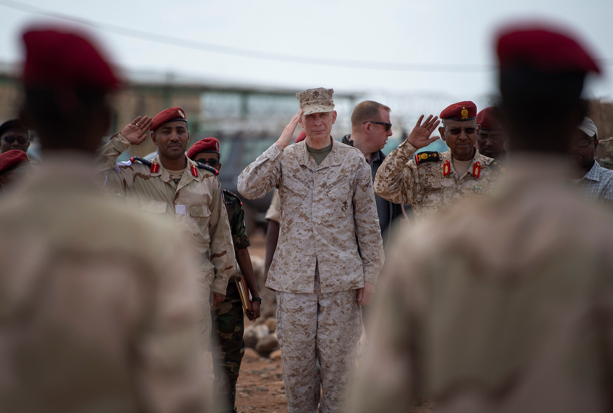 U.S. Marine Corps Gen. Thomas D. Waldhauser, commander of U.S. Africa Command, salutes prior to a demonstration by soldiers from the Djiboutian army's elite military force, the Rapid Intervention Battalion, during a visit with senior Djiboutian officials, including Chief of General Staff of the Djibouti Armed Forces Gen. Zakaria Cheikh Ibrahim, at a training base in Djibouti, March 21, 2019. Waldhauser visited in order to discuss the growth and development of Djiboutian security forces. (U.S. Air Force photo by Tech. Sgt. Shawn Nickel)