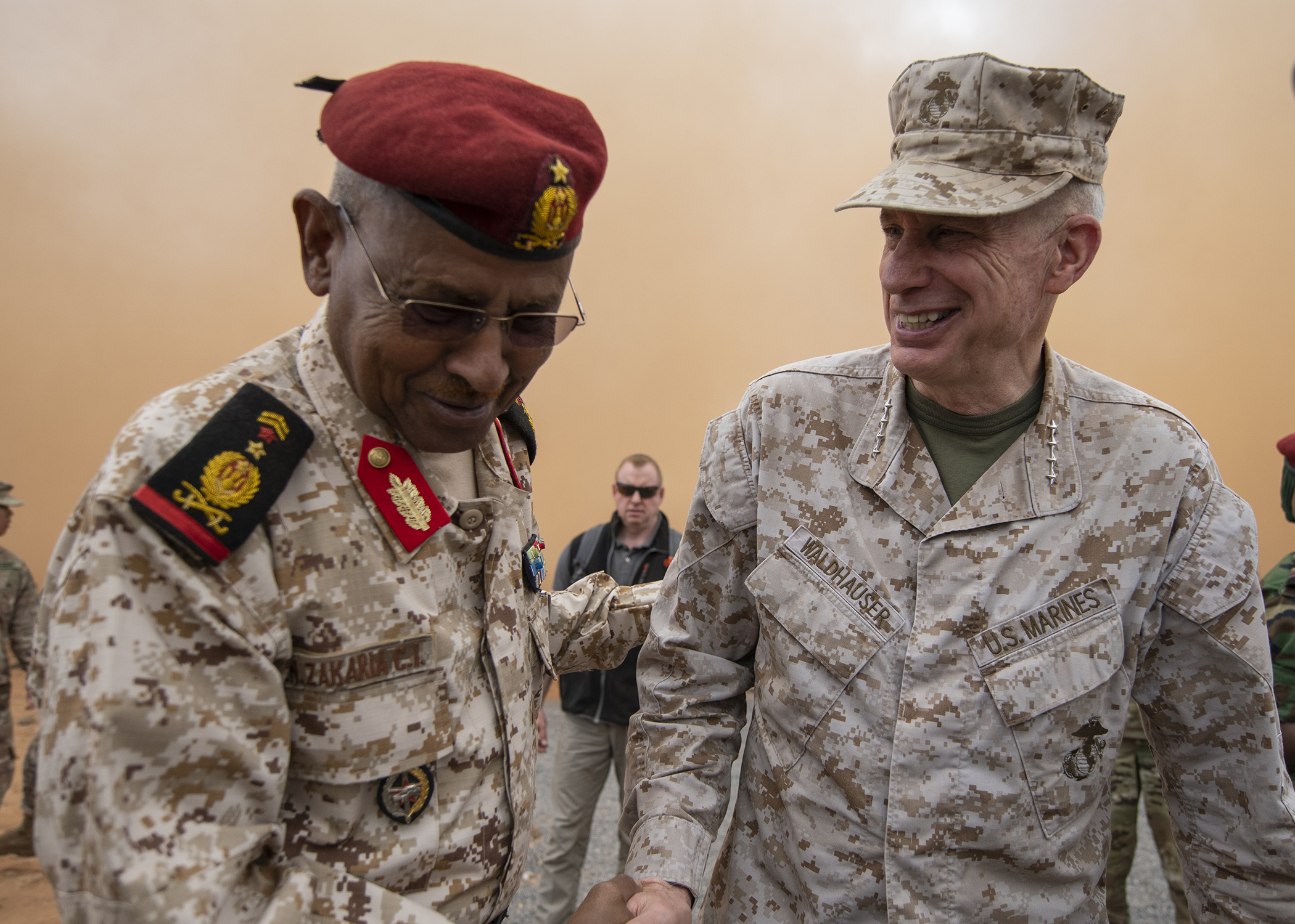 U.S. Marine Corps Gen. Thomas D. Waldhauser, right, commander of U.S. Africa Command, shakes hands with Chief of General Staff of the Djibouti Armed Forces Gen. Zakaria Cheikh Ibrahim, at a training base in Djibouti, March 21, 2019. While in Djibouti, Waldhauser observed the ongoing growth and development of the Rapid Intervention Battalion, the Djiboutian army's elite military force, which the U.S. is in the process of training and equipping at the request of the Djiboutian government. (U.S. Air Force photo by Tech. Sgt. Shawn Nickel)