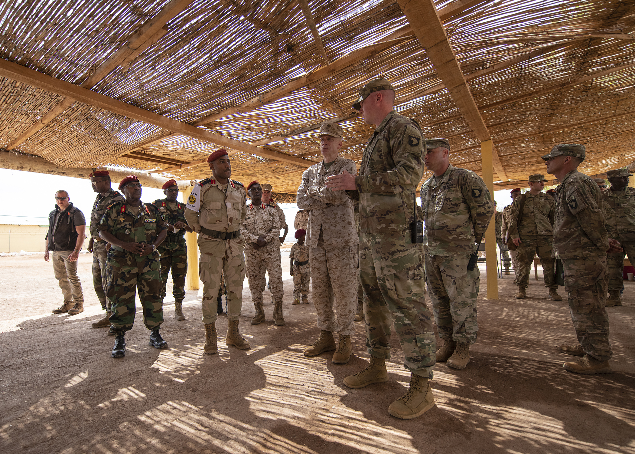 U.S. Marine Corps Gen. Thomas D. Waldhauser, center, commander of U.S. Africa Command, listens to a brief about partner training delivered by the officer in charge of NCO training for the Rapid Intervention Battalion (RIB), U.S. Army 1st Lt. Travis Holihan, Headquarters Company, 1-26 Infantry Battalion, 2nd Brigade Combat Team, 101st Airborne, assigned to Combined Joint Task Force-Horn of Africa, during a visit with senior Djiboutian officials, including Chief of General Staff of the Djibouti Armed Forces Gen. Zakaria Cheikh Ibrahim, at a training base in Djibouti, March 21, 2019. While in Djibouti, Waldhauser observed the ongoing growth and development of the RIB, the Djiboutian army's elite military force, which the U.S. is in the process of training and equipping at the request of the Djiboutian government. (U.S. Air Force photo by Tech. Sgt. Shawn Nickel)