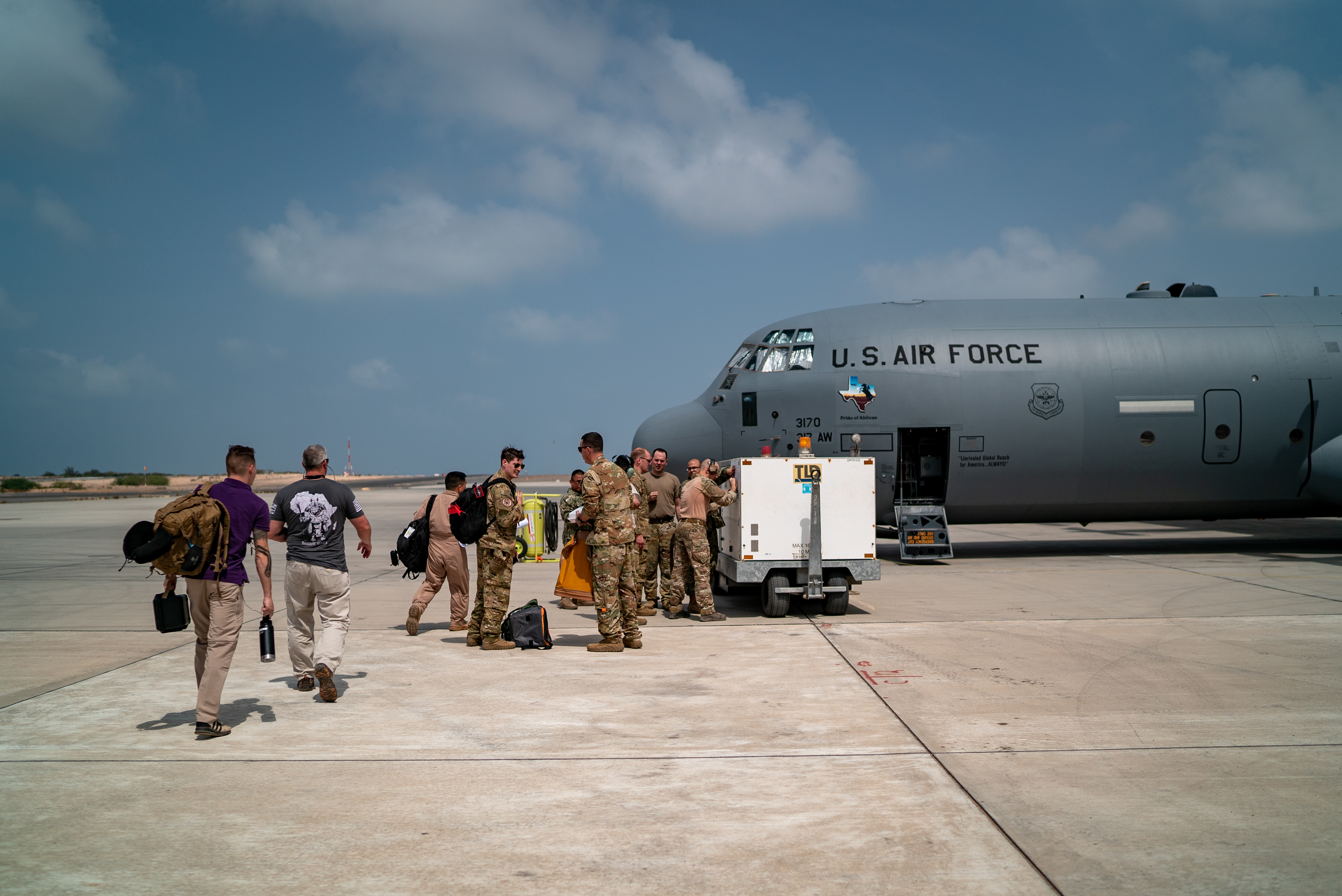 U.S. Airmen with the 449th Air Expeditionary Group supporting Combined Joint Task Force-Horn of Africa (CJTF-HOA), load supplies, personnel, and equipment onto a C-130J Hercules at Camp Lemonnier, Djibouti, March 26, 2019, for the U.S. Department of Defense's relief effort in the Republic of Mozambique and surrounding areas following Cyclone Idai. Teams from CJTF-HOA, which is leading DoD relief efforts, began immediate preparation to respond following a call for assistance from the U.S. Agency for International Development's Disaster Assistance Response Team.  (U.S. Air Force photo by Tech. Sgt. Thomas Grimes)