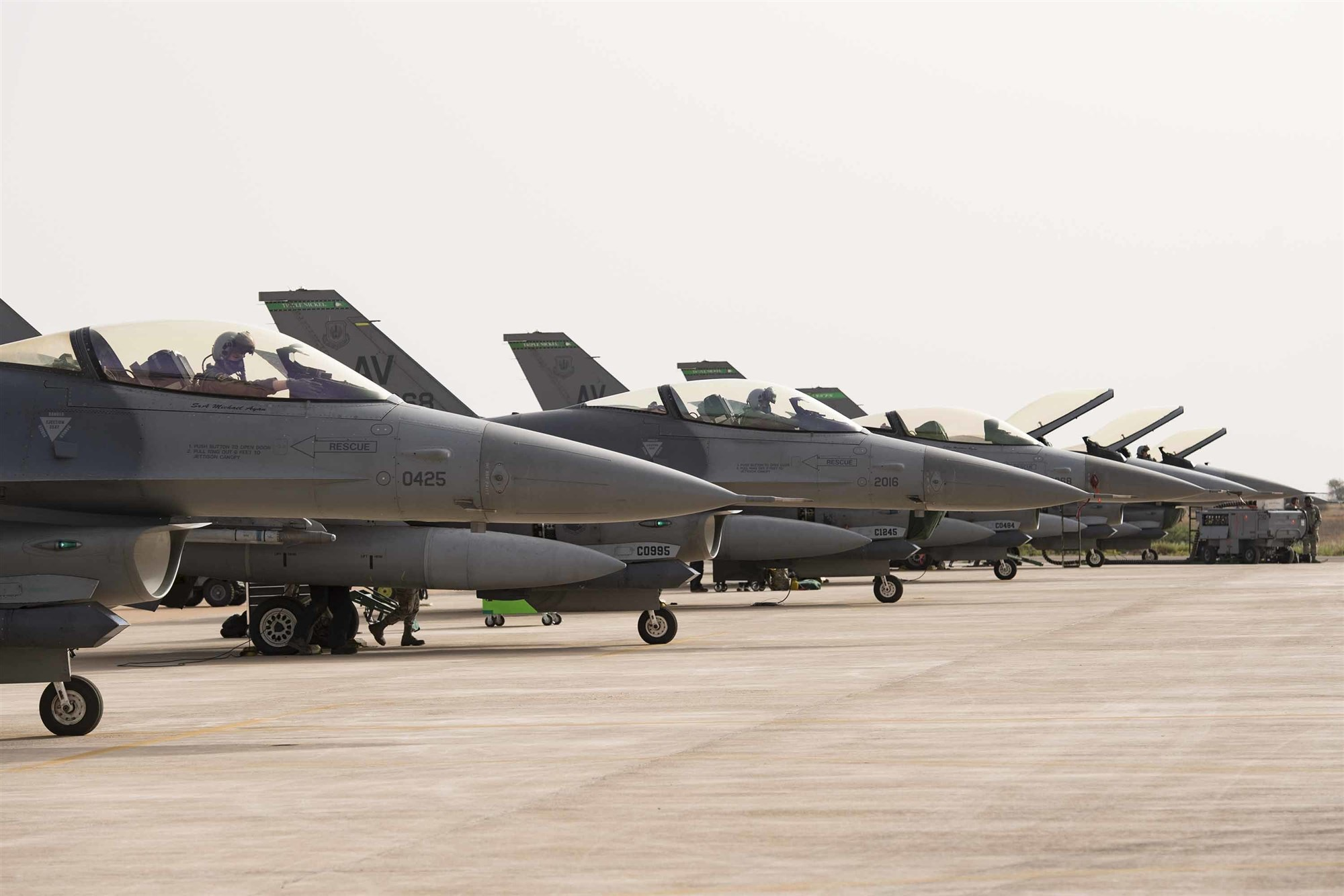 F-16C Fighting Falcons from the 555th Expeditionary Fighter Squadron rest on the flight line during exercise African Lion 2019 at Ben Guerir Air Base, Morocco, March 25, 2019. The squadron deployed out of the 31st Fighter Wing, Avaino Air Base, Italy. African Lion 2019 is a Chairman of the Joint Chiefs of Staff-sponsored, U.S. Africa Command-scheduled, U.S. Marine Corps Forces Europe and Africa-led, joint and combined exercise conducted in the Kingdom of Morocco with a spoke in Tunisia, and armed forces participants in from Canada, France, Senegal, Spain, and the United Kingdom. (U.S. Air Force photo by Staff Sgt. Ceaira Tinsley)