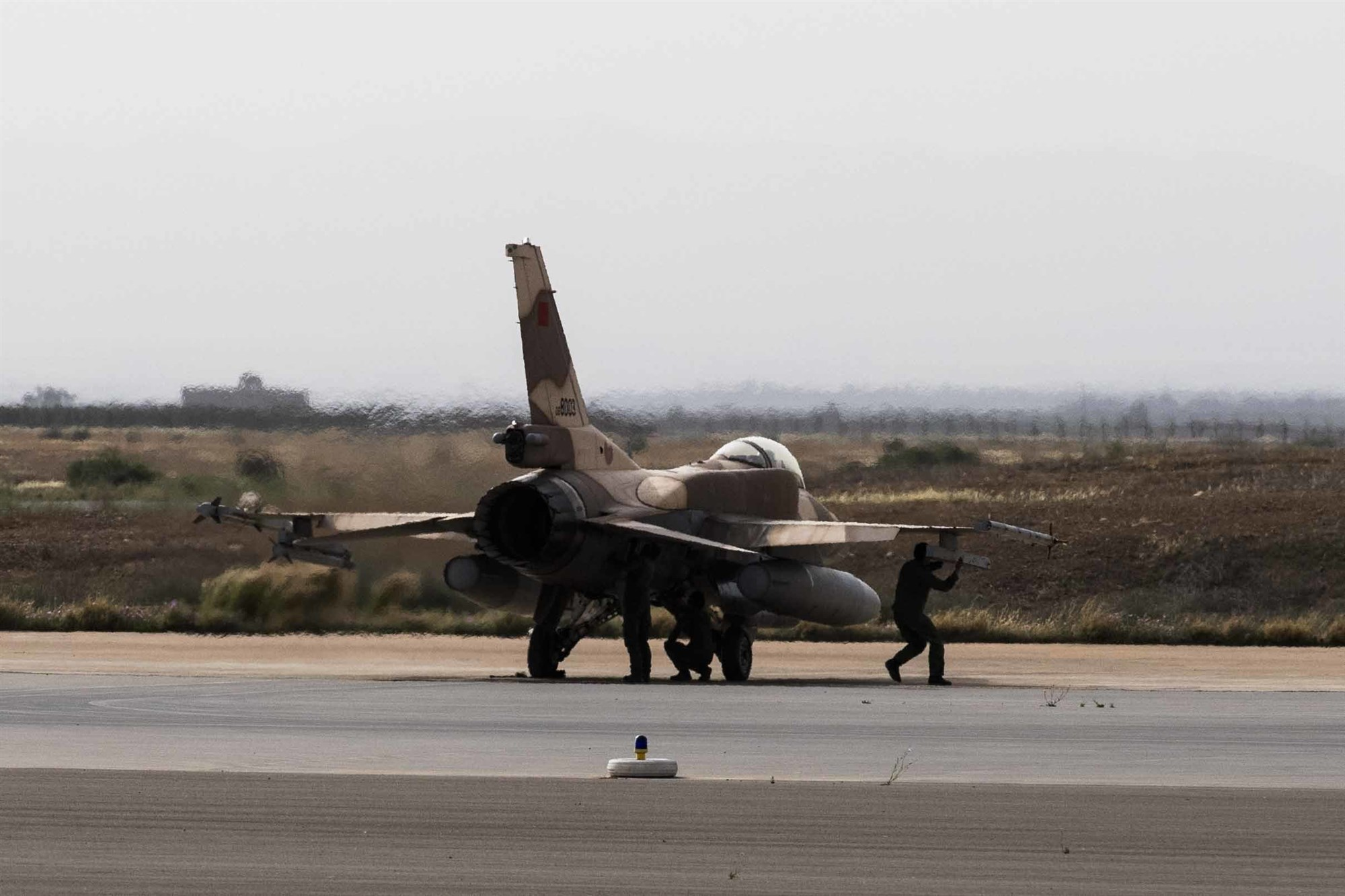 Royal Moroccan Air Force maintainers check a Moroccan F-16 prior to takeoff during exercise African Lion 2019 at Ben Guerir Air Base, Morocco, March 25, 2019. The exercise took place in the Kingdom of Morocco, a strong U.S. partner in counterterrorism efforts and a pivotal player in the issues confronting the broader Middle East and North Africa region. African Lion 2019 is a Chairman of the Joint Chiefs of Staff-sponsored, U.S. Africa Command-scheduled, U.S. Marine Corps Forces Europe and Africa-led, joint and combined exercise conducted in the Kingdom of Morocco with a spoke in Tunisia, and armed forces participants in from Canada, France, Senegal, Spain, and the United Kingdom. (U.S. Air Force photo by Staff Sgt. Ceaira Tinsley)