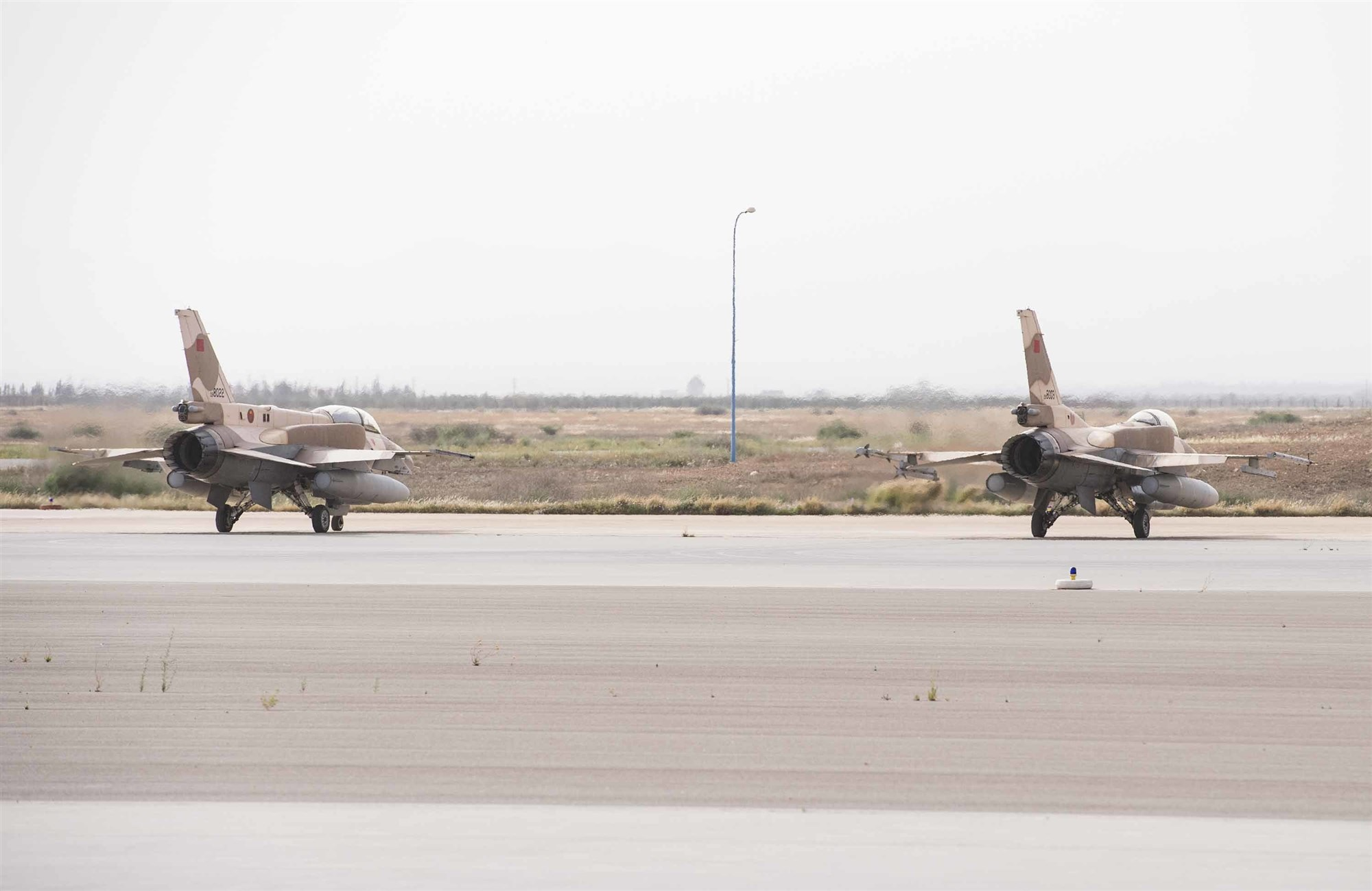 Two Royal Moroccan Air Force F-16s rests on the flight line during exercise African Lion 2019 at Ben Guerir Air Base, Morocco, March 25, 2019. The exercise allowed Moroccan and U.S. F-16s to train together on the tactics, techniques and procedures necessary in a real-world scenario  to counter-violent extremist organizations. African Lion 2019 is a Chairman of the Joint Chiefs of Staff-sponsored, U.S. Africa Command-scheduled, U.S. Marine Corps Forces Europe and Africa-led, joint and combined exercise conducted in the Kingdom of Morocco with a spoke in Tunisia, and armed forces participants in from Canada, France, Senegal, Spain, and the United Kingdom. (U.S. Air Force photo by Staff Sgt. Ceaira Tinsley)