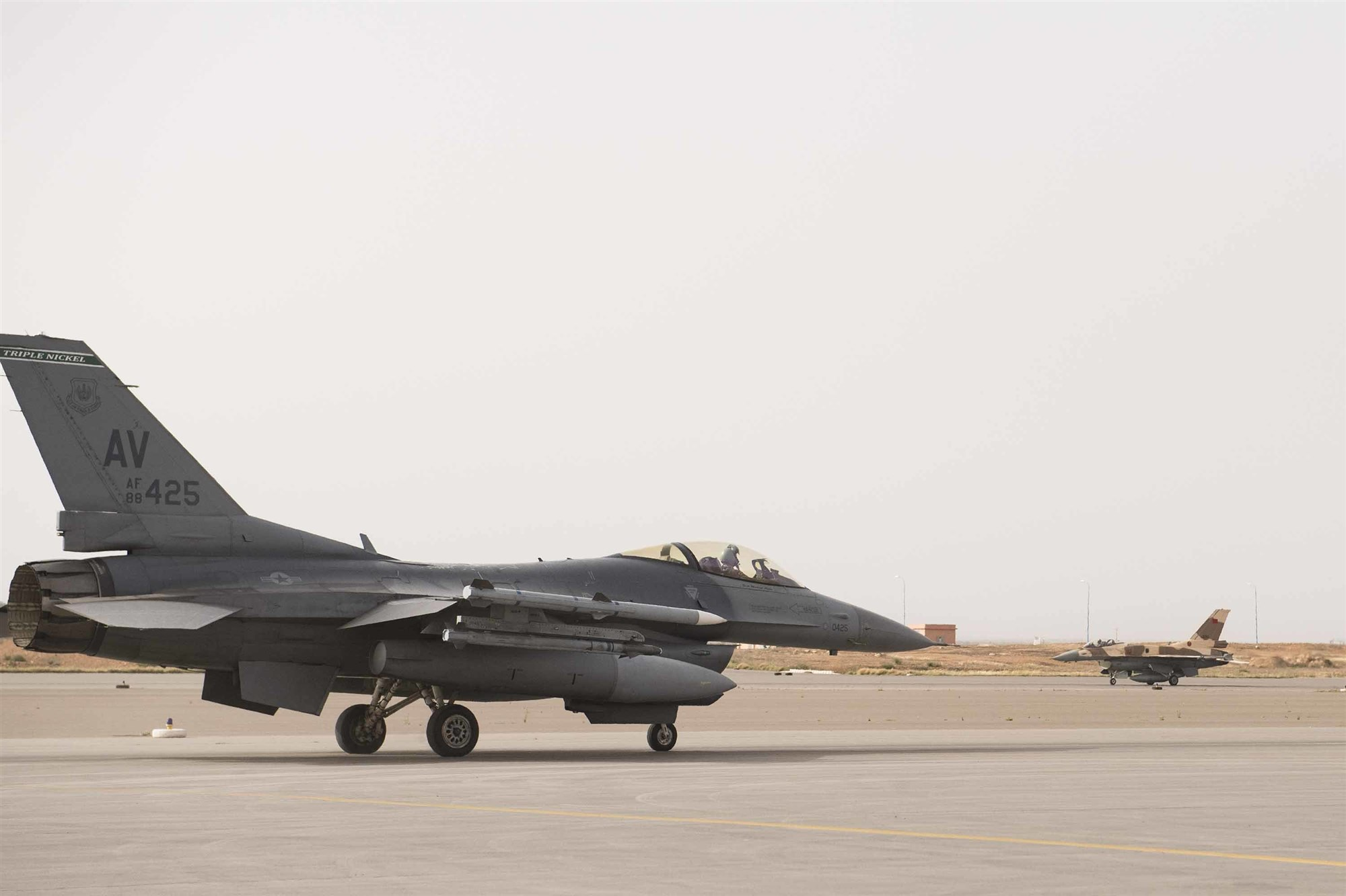 An F-16C Fighting Falcon from the 555th Expeditionary Fighter Squadron taxis during exercise African Lion 2019 at Ben Guerir Air Base, Morocco, March 25, 2019. Approximately 1,100 U.S. military personnel arrived in the Kingdom of Morocco to take part in the annual exercise. African Lion 2019 is a Chairman of the Joint Chiefs of Staff-sponsored, U.S. Africa Command-scheduled, U.S. Marine Corps Forces Europe and Africa-led, joint and combined exercise conducted in the Kingdom of Morocco with a spoke in Tunisia, and armed forces participants in from Canada, France, Senegal, Spain, and the United Kingdom. (U.S. Air Force photo by Staff Sgt. Ceaira Tinsley)