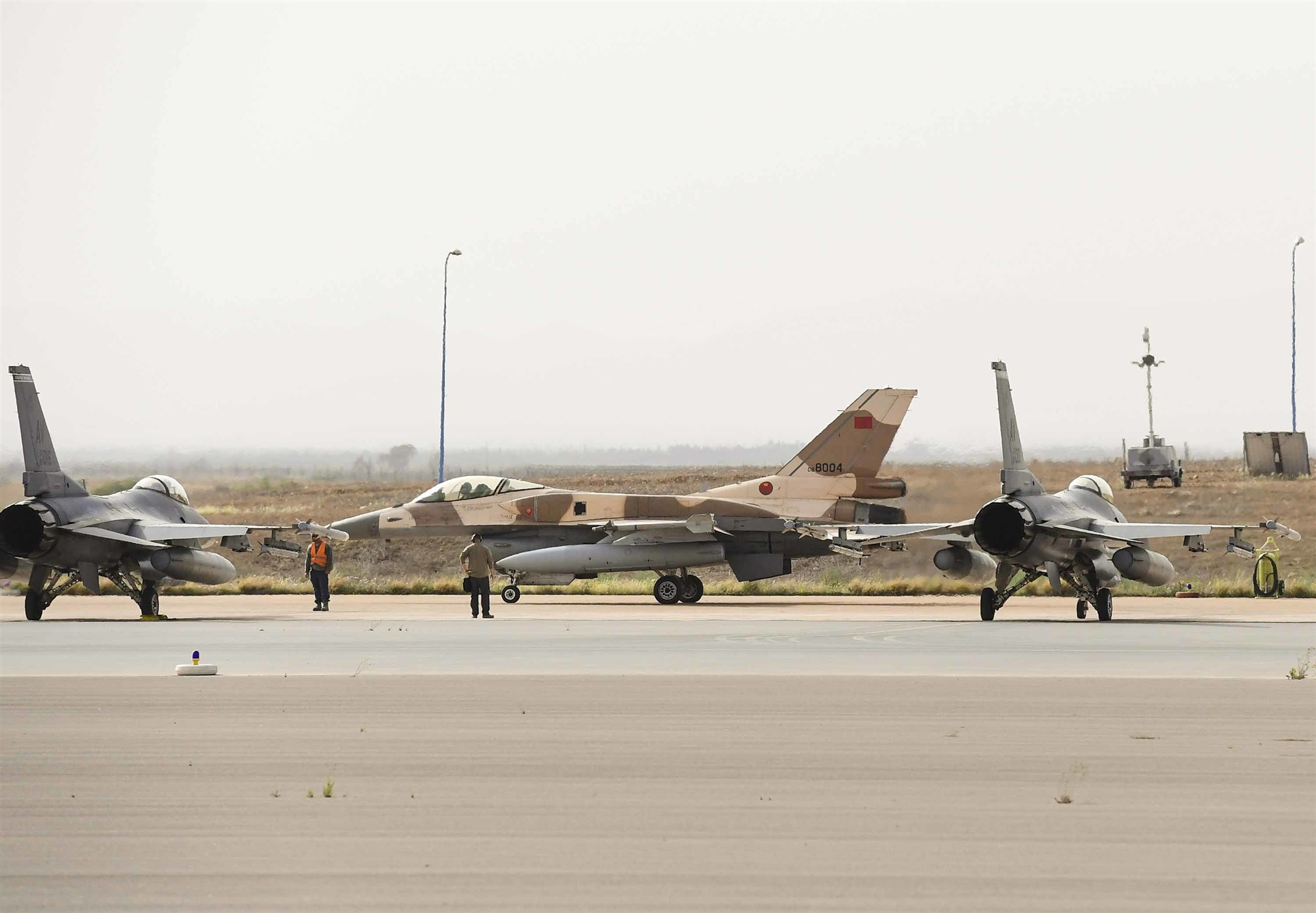 A Royal Moroccan Air Force F-16 taxis past two F-16C Fighting Falcons from the 555th Expeditionary Fighter Squadron during exercise African Lion 2019 at Ben Guerir Air Base, Morocco, March 25, 2019. During the exercise, U.S. and Moroccan F-16s conducted tactical training, reinforcing the long-standing relationship between the two countries and enhancing bilateral security cooperation. African Lion 2019 is a Chairman of the Joint Chiefs of Staff-sponsored, U.S. Africa Command-scheduled, U.S. Marine Corps Forces Europe and Africa-led, joint and combined exercise conducted in the Kingdom of Morocco with a spoke in Tunisia, and armed forces participants in from Canada, France, Senegal, Spain, and the United Kingdom. (U.S. Air Force photo by Staff Sgt. Ceaira Tinsley)